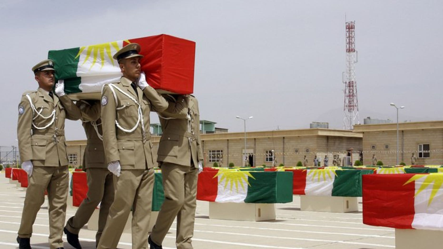 File picture shows Iraqi Kurdish police officers carrying a coffin draped with the Kurdish flag, on May 28, 2012. A suicide bomber killed eight Kurdish police in northern Iraq on Sunday, a district official and a doctor said.