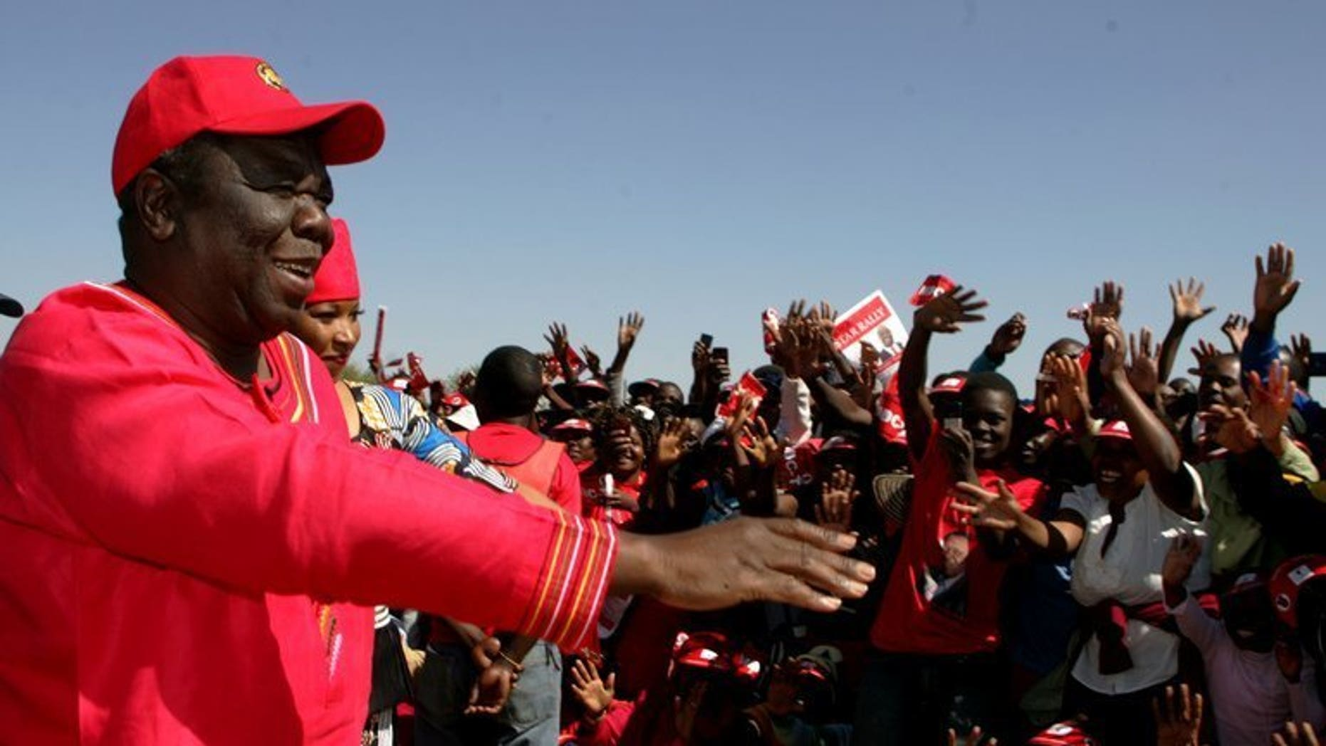 Zimbabwe PM Morgan Tsvangirai addresses an election campaign rally at Mkoba Stadium in Gweru on July 21, 2013. Zimbabwean police on Sunday arrested the election organiser of Prime Minister Morgan Tsvangirai's party after he reported marked ballot papers were found in a dustbin following early voting, the party and police said.