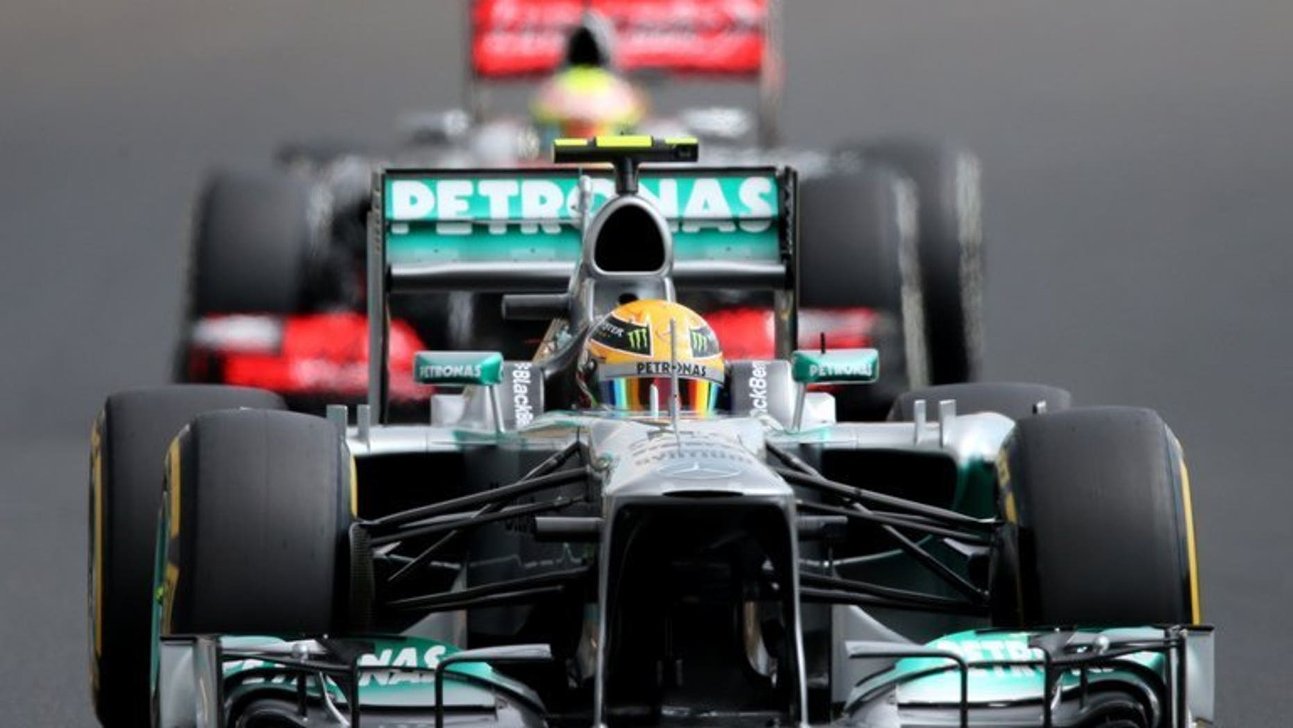 Mercedes' British driver Lewis Hamilton drives during the qualifying session at the Hungaroring circuit in Budapest on July 27, 2013. Hamilton of Mercedes won the Hungarian Grand Prix from pole on Sunday, with Lotus' Kimi Raikkonen second and defending champion Sebastian Vettel of Red Bull third.