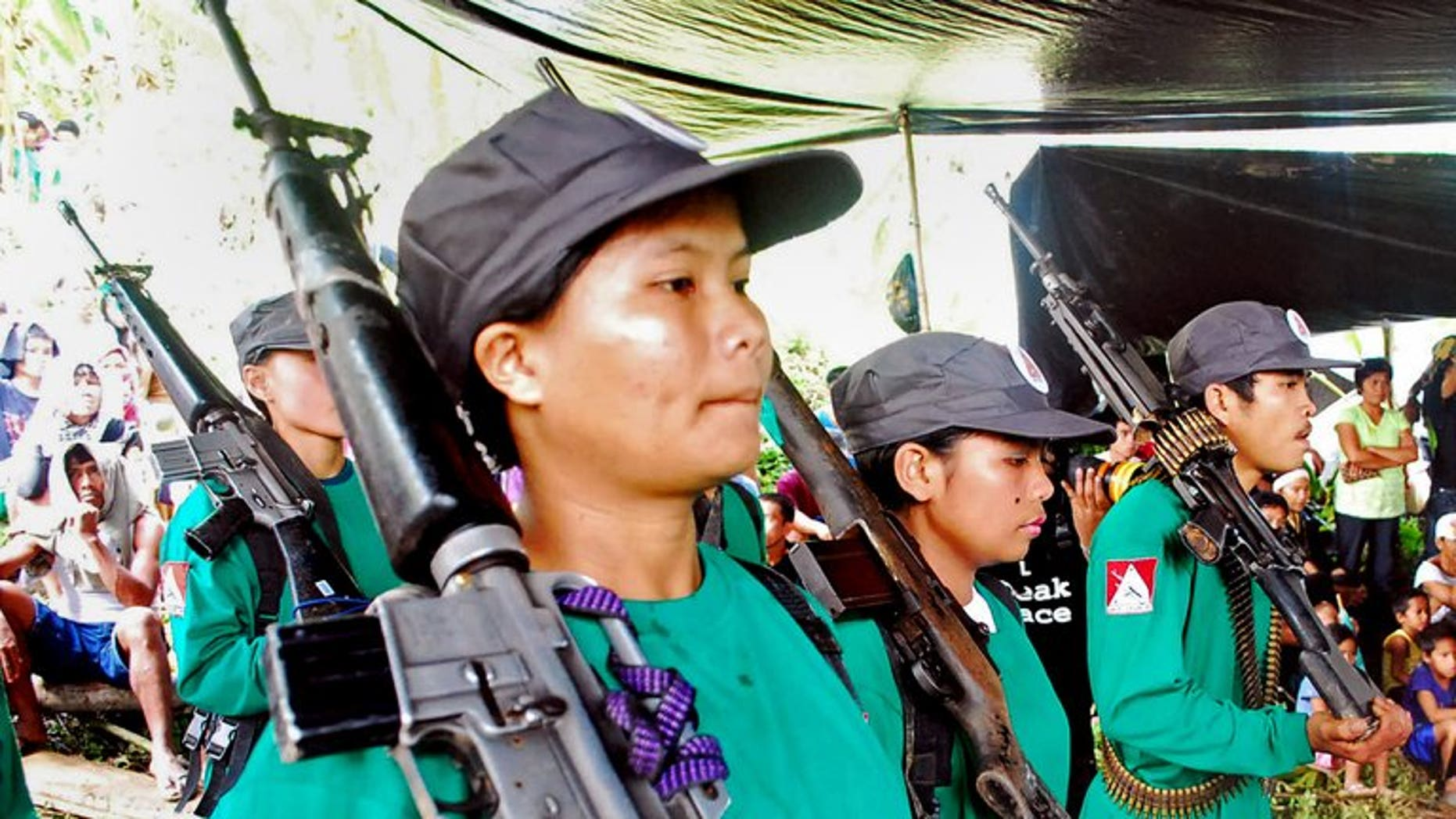 New People's Army rebels drill at an unspecified location in Surigao del Sur province, Mindanao, in December 2009. Philippine police and troops Sunday captured a woman who is one of the country's most wanted communist guerrillas, officials said.