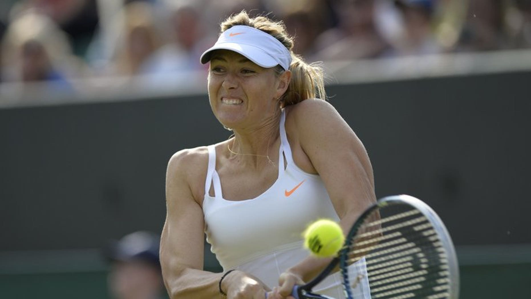 Russia's Maria Sharapova plays at Wimbledon on June 26, 2013. The world number two has withdrawn from the WTA Rogers Cup hardcourt event in Toronto next month because of a nagging left hip injury, organizers said.