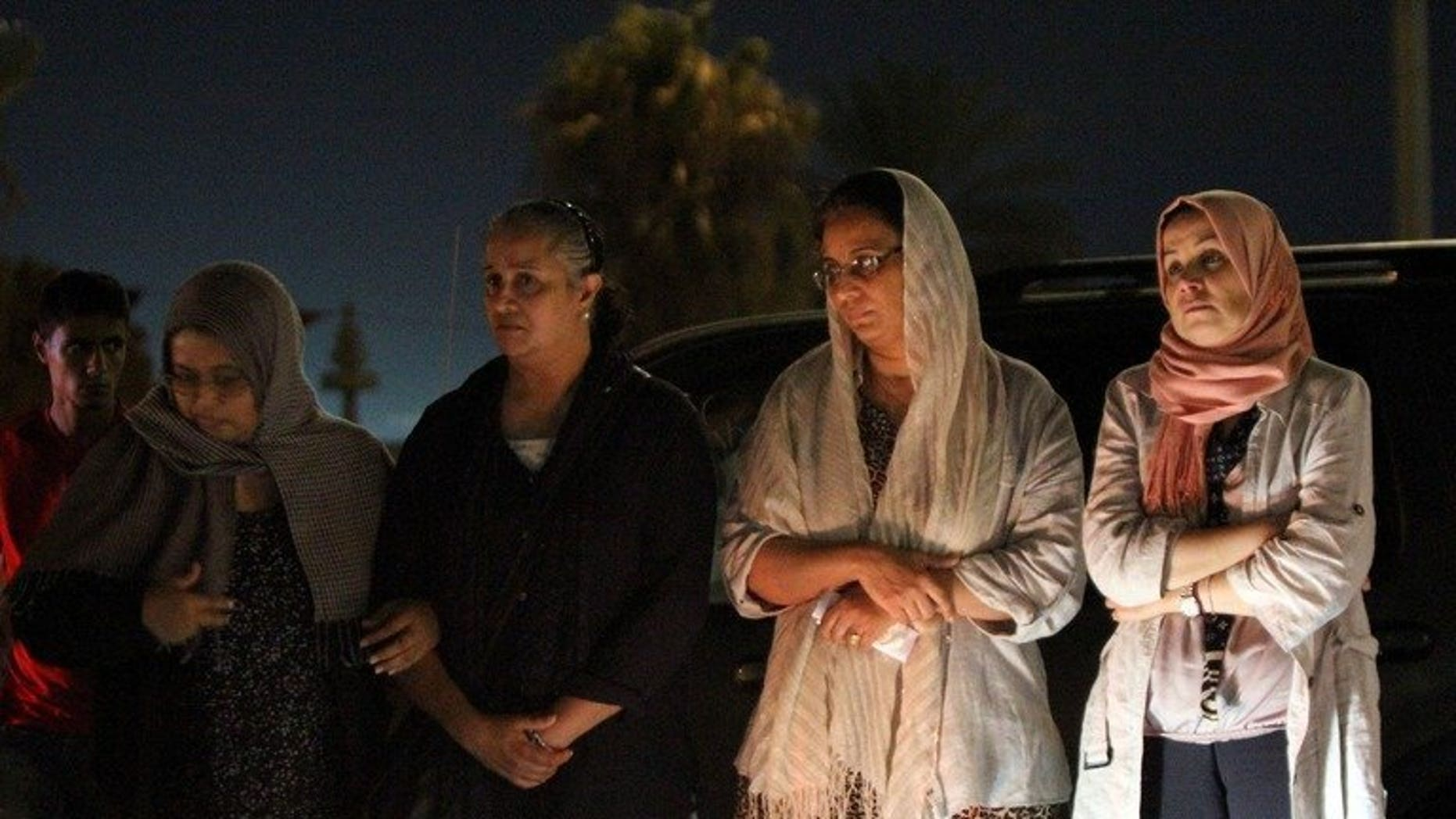 Benghazi residents gather in front of the Tibesti hotel following the assasination of a prominent Libyan political activist on July 27, 2013. Two powerful explosions went off near the courthouse in Benghazi Sunday night, leaving 10 people injured and causing damage, witnesses and a security source said.