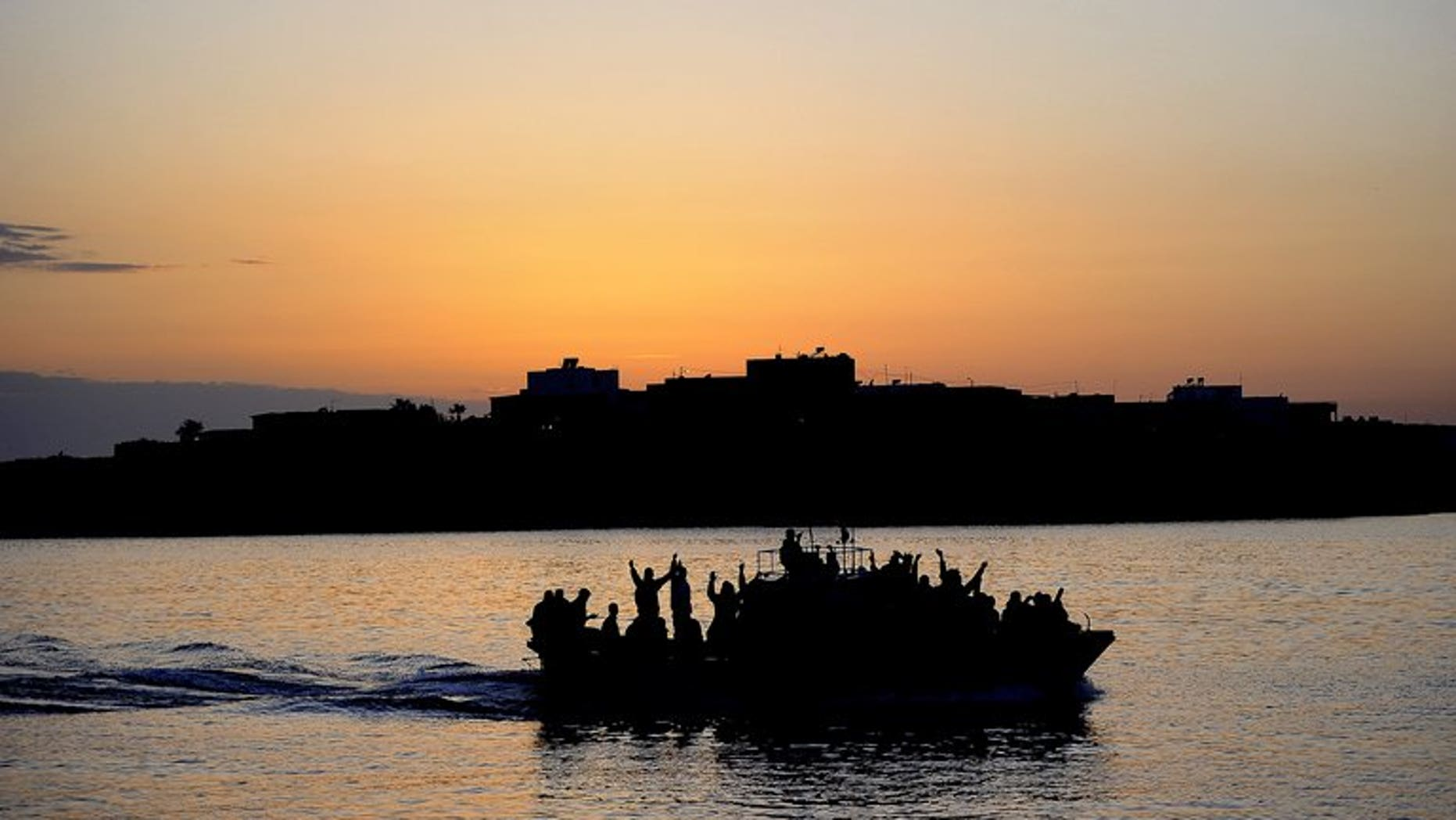 A boat carring Tunisian migrants enters the port of Lampedusa on April 12, 2011. Italian Interior Minister Angelo Alfano called for human traffickers who shuttle migrants across the sea to Italy to be stopped on Sunday, after 31 boat people drowned during an attempted crossing.
