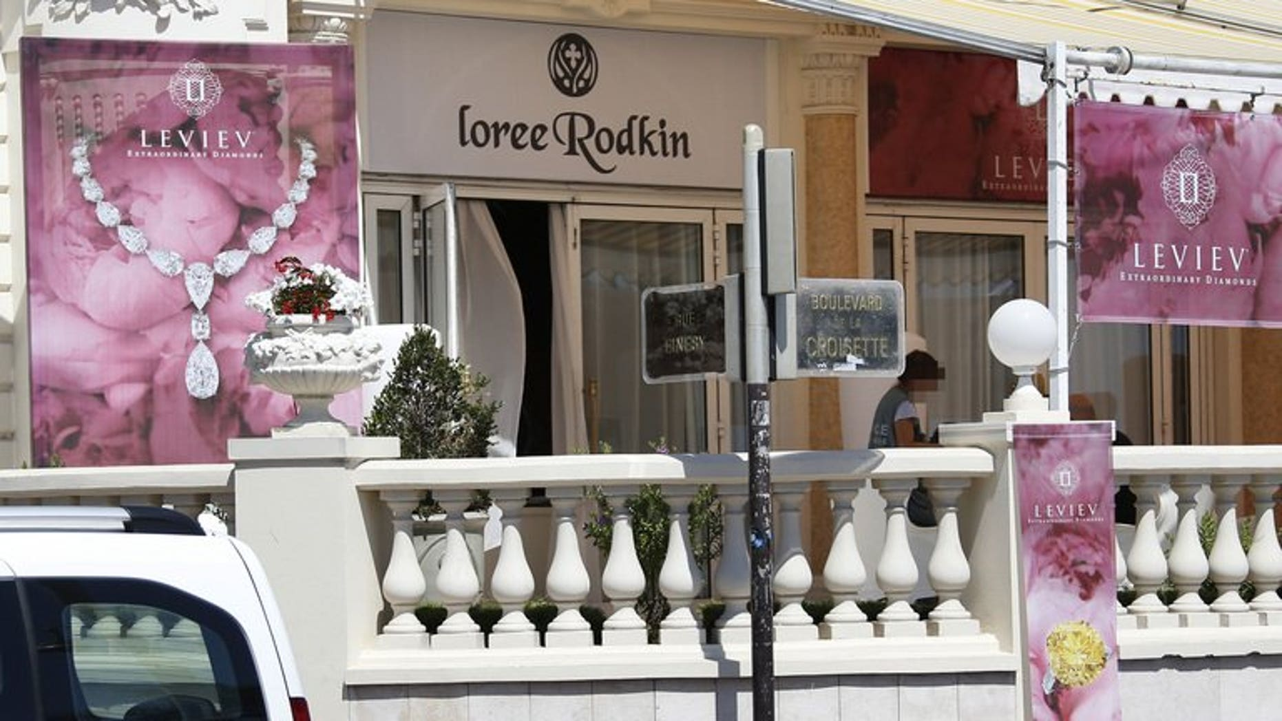 A French policeman investigates outside the Carlton Hotel on July 28, 2013 in the French Riviera resort of Cannes, after an armed man held up the jewellery exhibitionmaking away with jewels estimated to be worth about 40 million euros ($53 million).