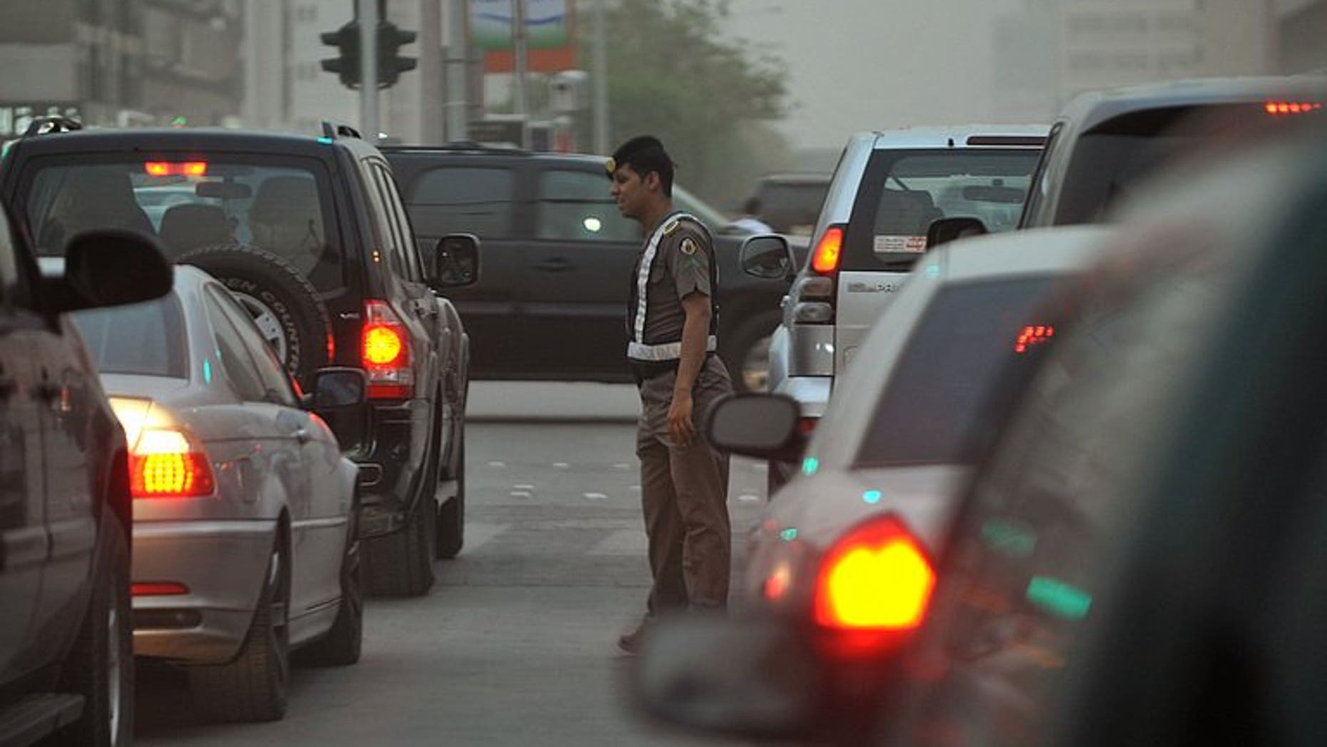 File picture shows a Saudi policeman monitoring traffic in Riyadh. Saudi Arabia has granted three foreign consortiums contracts to build a Riyadh metro, a project worth $22.5 billion, the kingdom announced at a news conference in the capital late on Sunday.