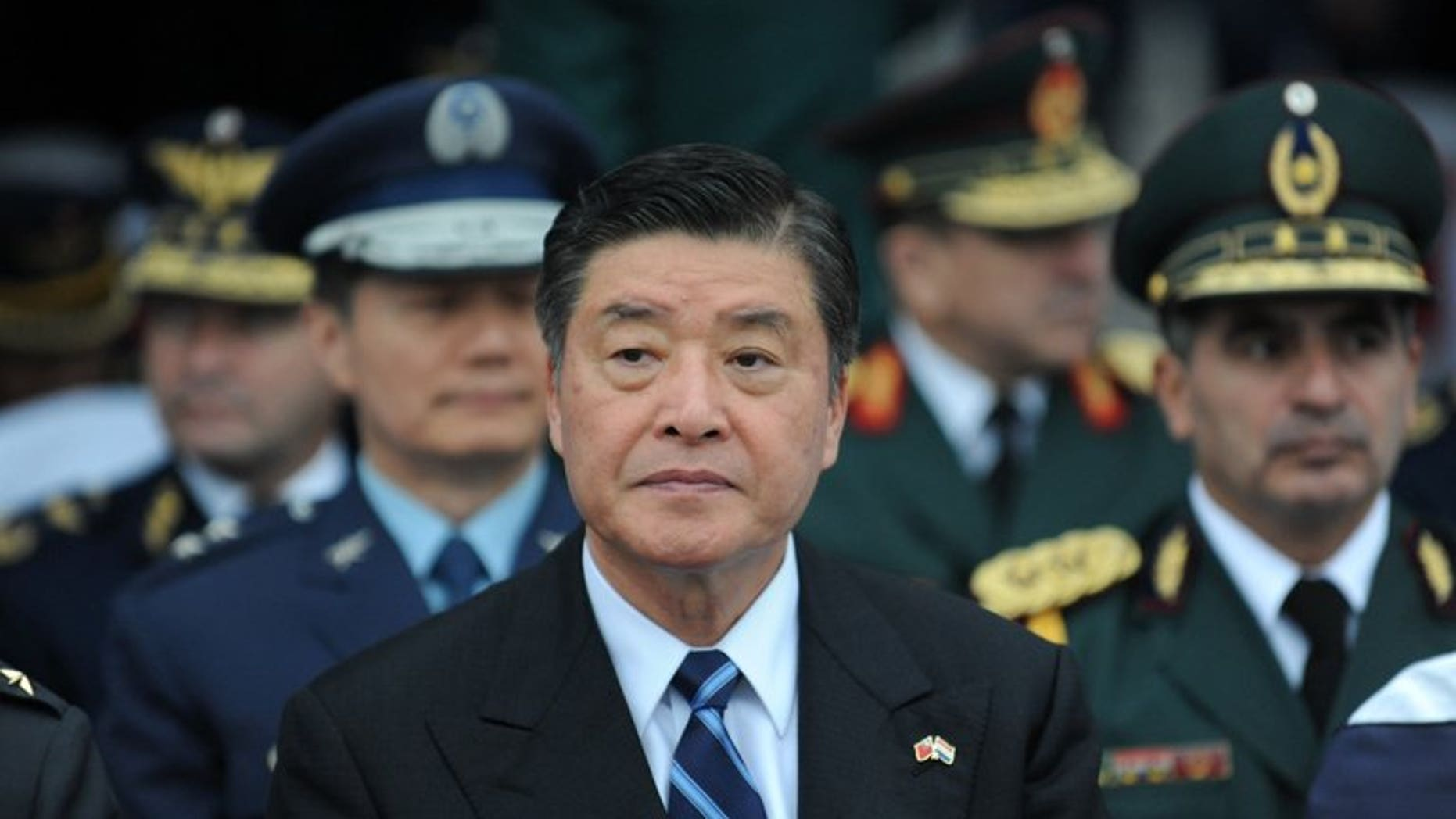 This file photo shows Taiwan's Defence Minister Kao Hua-chu during his recent visit to Paraguay, on July 9, 2013. Kao has resigned, Premier Jiang Yi-huah said on Monday, after the death of a corporal who was allegedly abused by the military in a case that sparked outrage across the island.