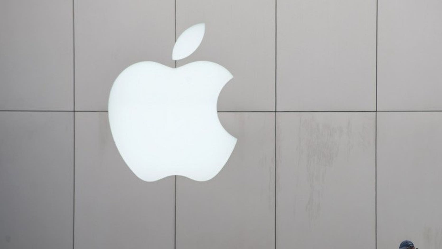 An Apple logo is displayed at a shopping mall in Beijing on March 29, 2013. Three Chinese factories making Apple products impose excessive overtime and employ minors, a US-based advocacy group said, renewing scrutiny of labour practices by the US tech giant's suppliers.