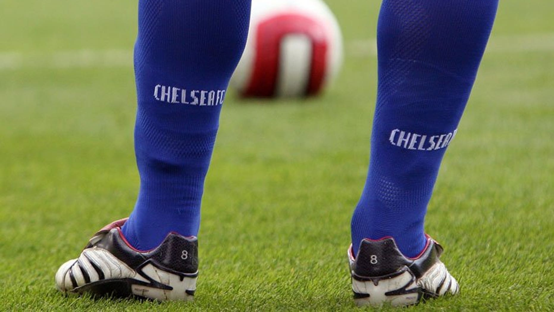 Chelsea's Frank Lampard waits to take a free kick during a Premeirship match against Fulham in London, September 23, 2006. Football anti-racism group Kick It Out launched a new mobile phone tool for fans and players to report racist or homophobic abuse, after a number of high-profile incidents last season.