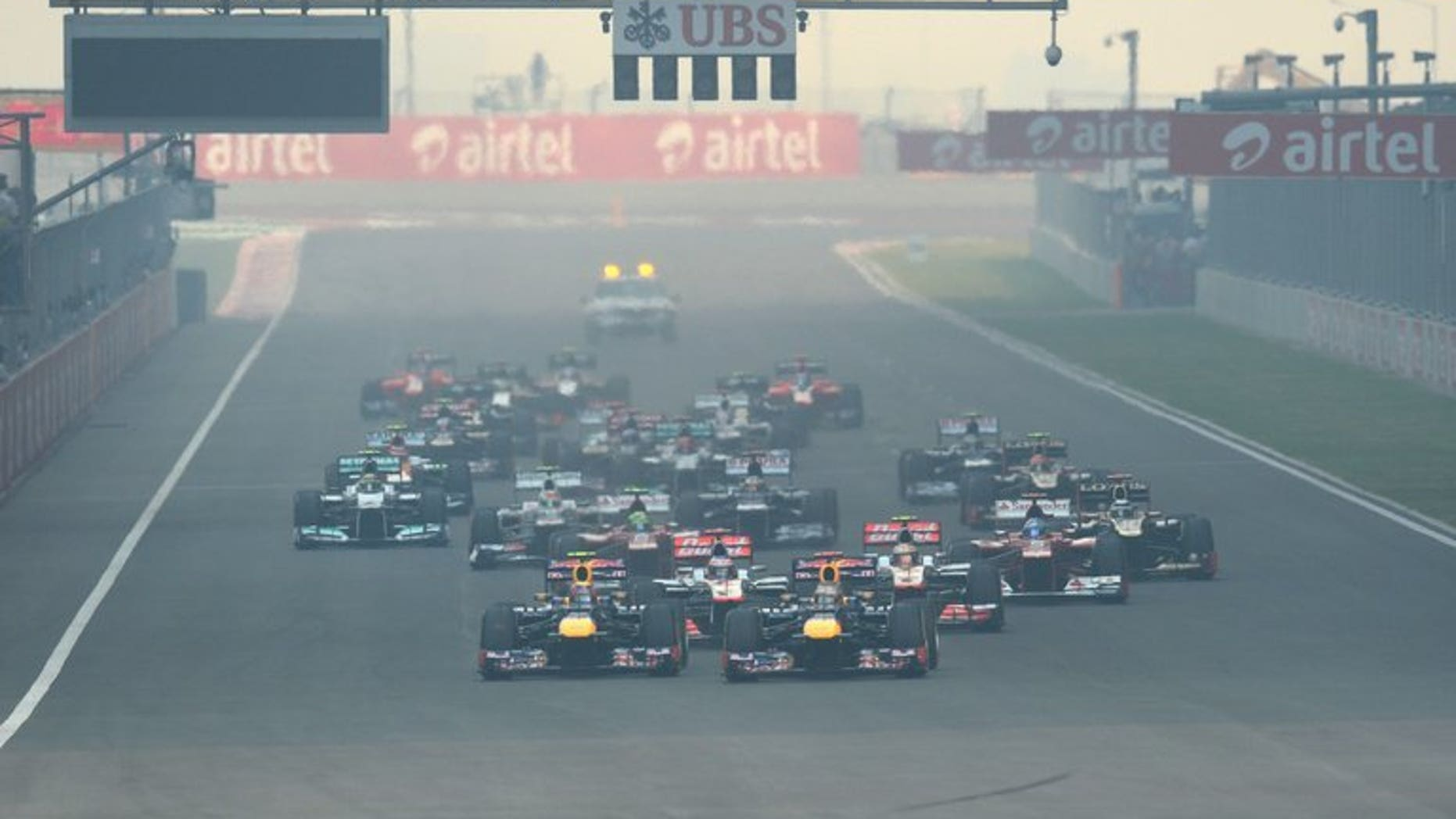 Drivers leave the starting grid at the start of the Formula One Indian Grand Prix in Greater Noida, on the outskirts of New Delhi on October 28, 2012. Political and financial issues could threaten next year's Indian and South Korean grand prix, as Formula One paymaster Bernie Ecclestone looks to add new races in the United States, Russia and Austria.