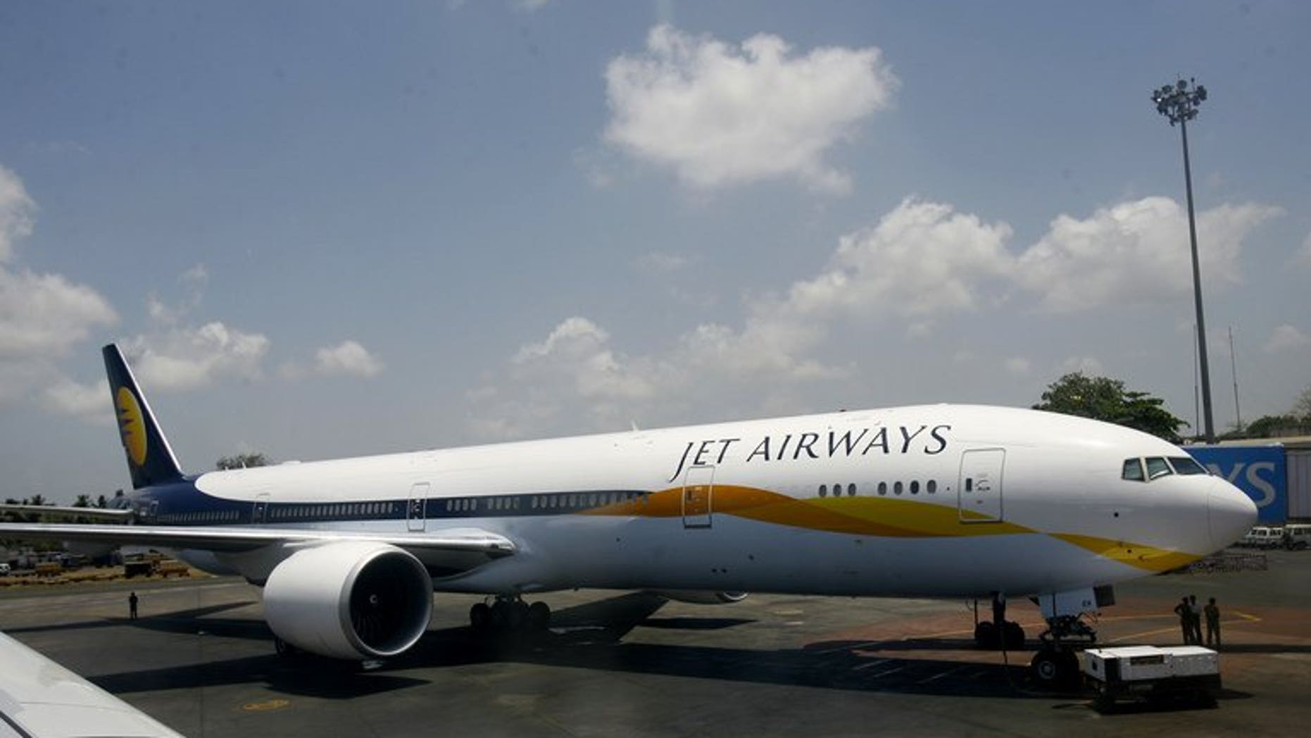 A Jet Airways Boeing 777-300ER stands on the tarmac at Chatrapati Shivaji International Airport in Mumbai on May 13, 2007. India's foreign investment panel approved a plan for Abu Dhabi-based Etihad to buy a stake in Indian airline Jet, but the pact still faces other hurdles.