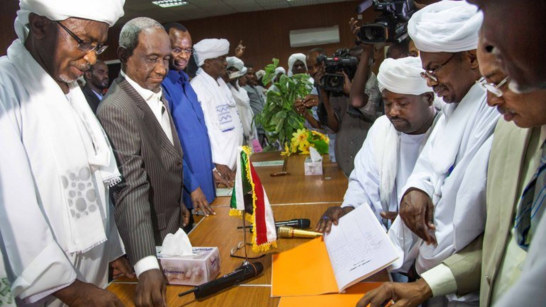 Government officials (left) with leaders of the Abbala and Beni Hussein tribes in El Fasher, N.Darfur, last week. Fighting between rival Arab tribes in Sudan's Darfur region spread on Monday, after clashes last week left scores dead, a leader of one of the tribes said.