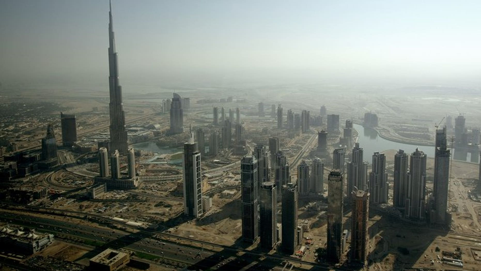 An aerial view shows the Burj Khalifa rising among skyscrapers in Dubai on December 17, 2009. Dubai-based real estate giant Emaar Properties said Monday its net profit increased 10 percent to $184 million in the second quarter of 2013, as sales nearly quadrupled.