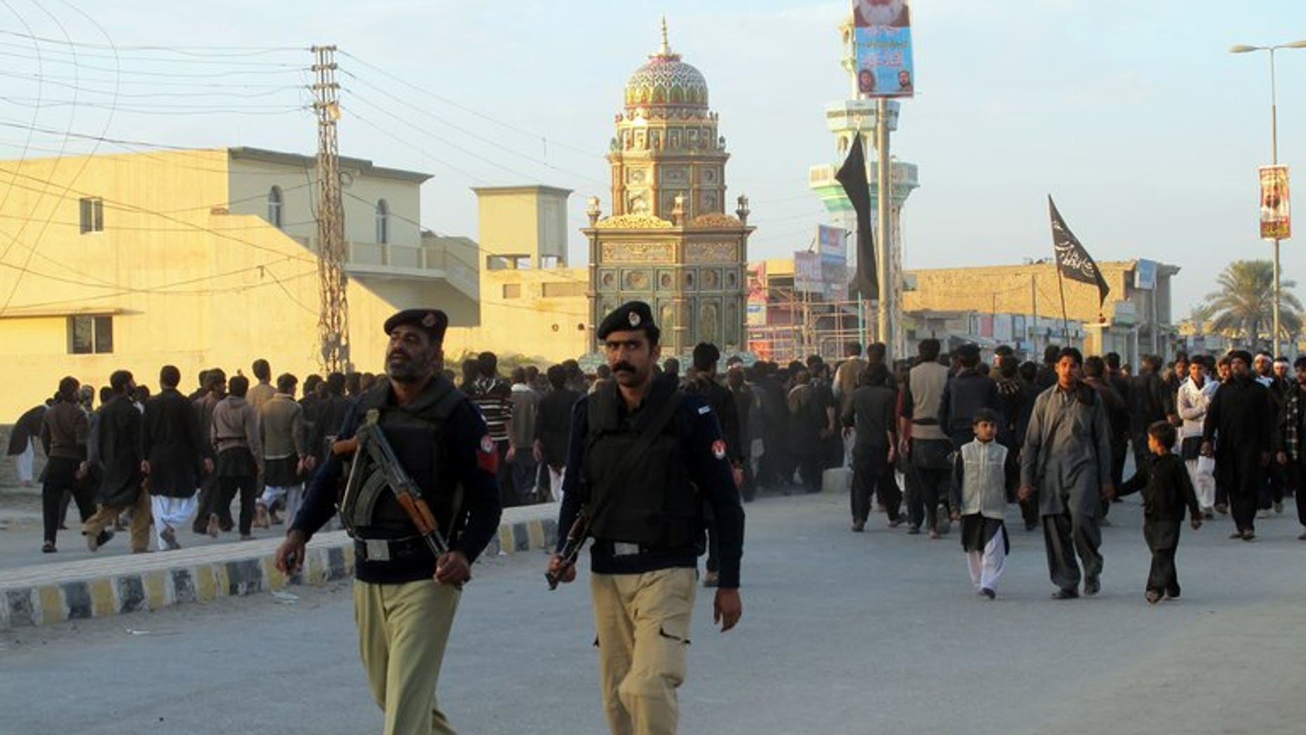 Pakistani policemen are seen in the city of Dera Ismail Khan on November 25, 2012. Militants attacked a prison in the city armed with mortars and are locked in a gunfight with police and security forces, officials said.