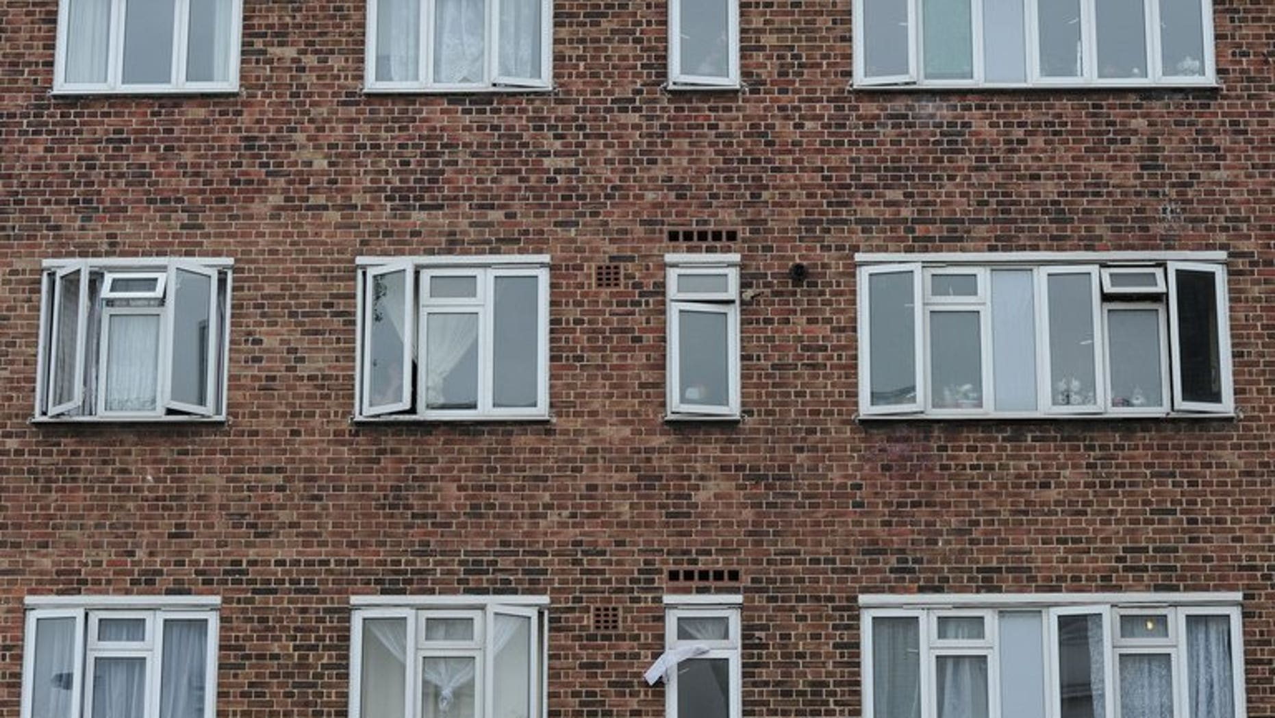"""A block of flats is pictured in west London, on August 30, 2011. Cuts to social housing benefit dubbed the """"bedroom tax"""" do not discriminate against disabled people, a High Court ruled Tuesday, dismissing a legal challenge by campaigners."""