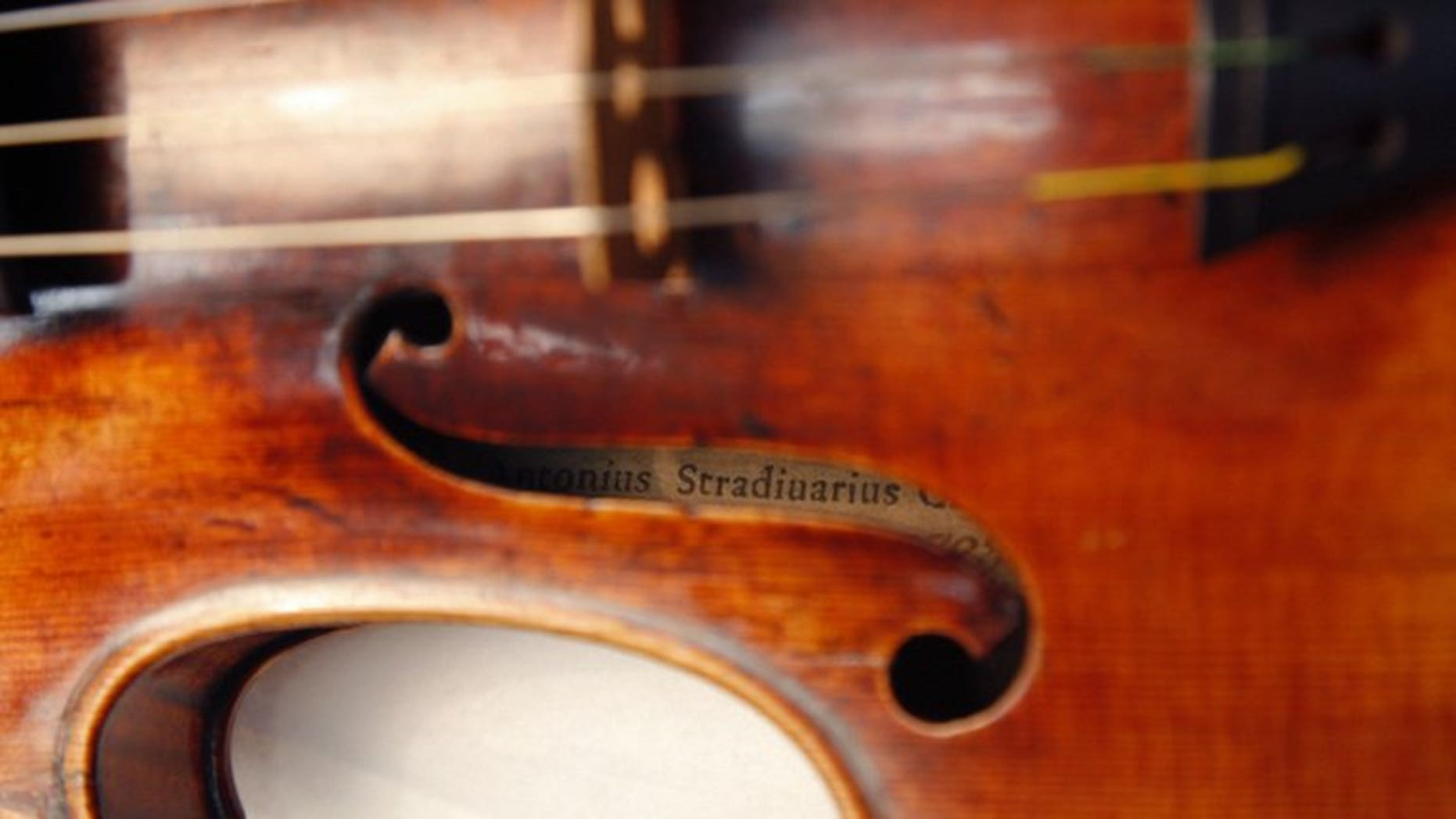 A Stradivarius violin is pictured at the Musee de la Musique in Paris, on December 3, 2009. British police have recovered a rare Stradivarius violin worth ??1.2 million ($1.8 million, 1.4 million euros) that was stolen from its owner in a London railway cafe in 2010.