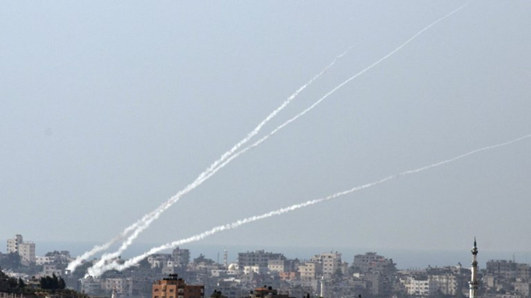 File picture shows a trail of smoke from rockets launched from the Palestinian Gaza Strip towards southern Israel on October 24, 2012. A rocket fired from Gaza hit southern Israel Tuesday, causing no casualties, a police spokesman said, as a first full day of resumed Middle East peace talks was to open.