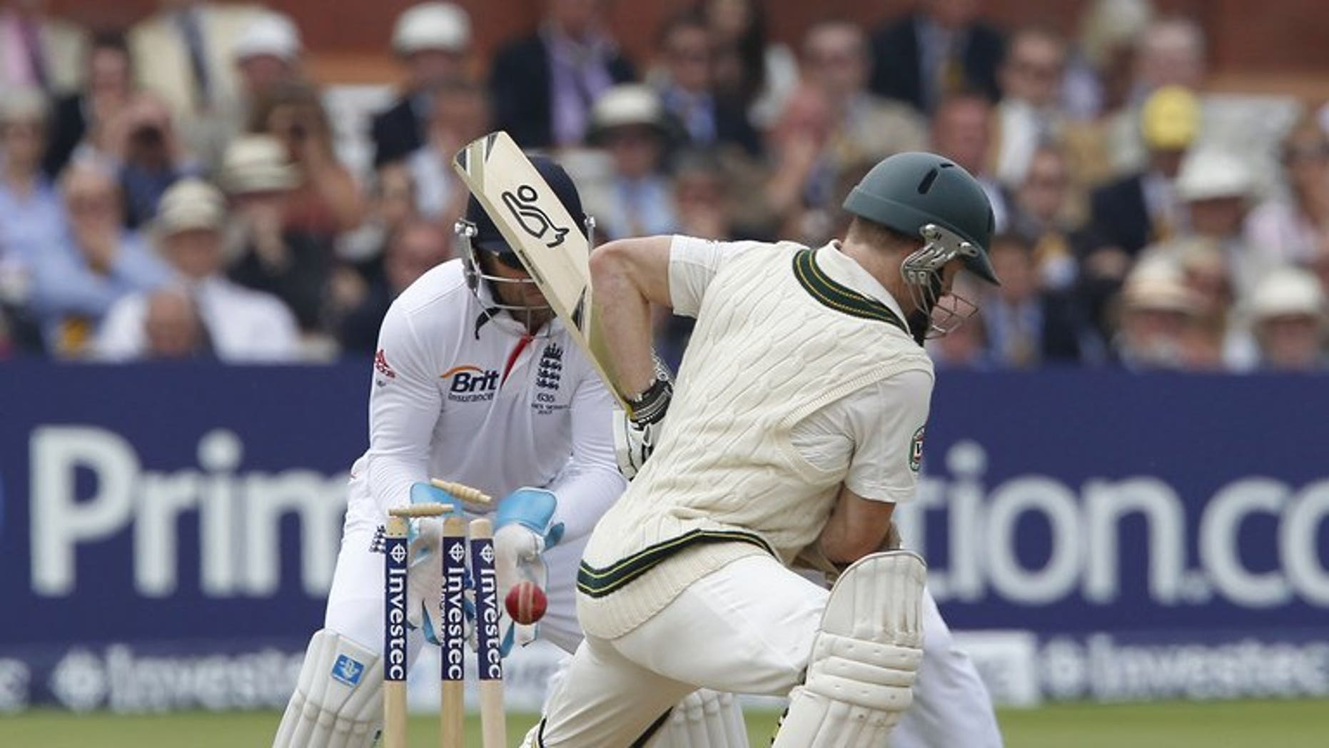 Chris Rogers is bowled by England's Graeme Swann (not pictured) at Lord's on July 21. Rogers said on Tuesday that Australia could only benefit from David Warner's return, even though the opener may have to make way if his fellow left-hander plays in the third Test against England.