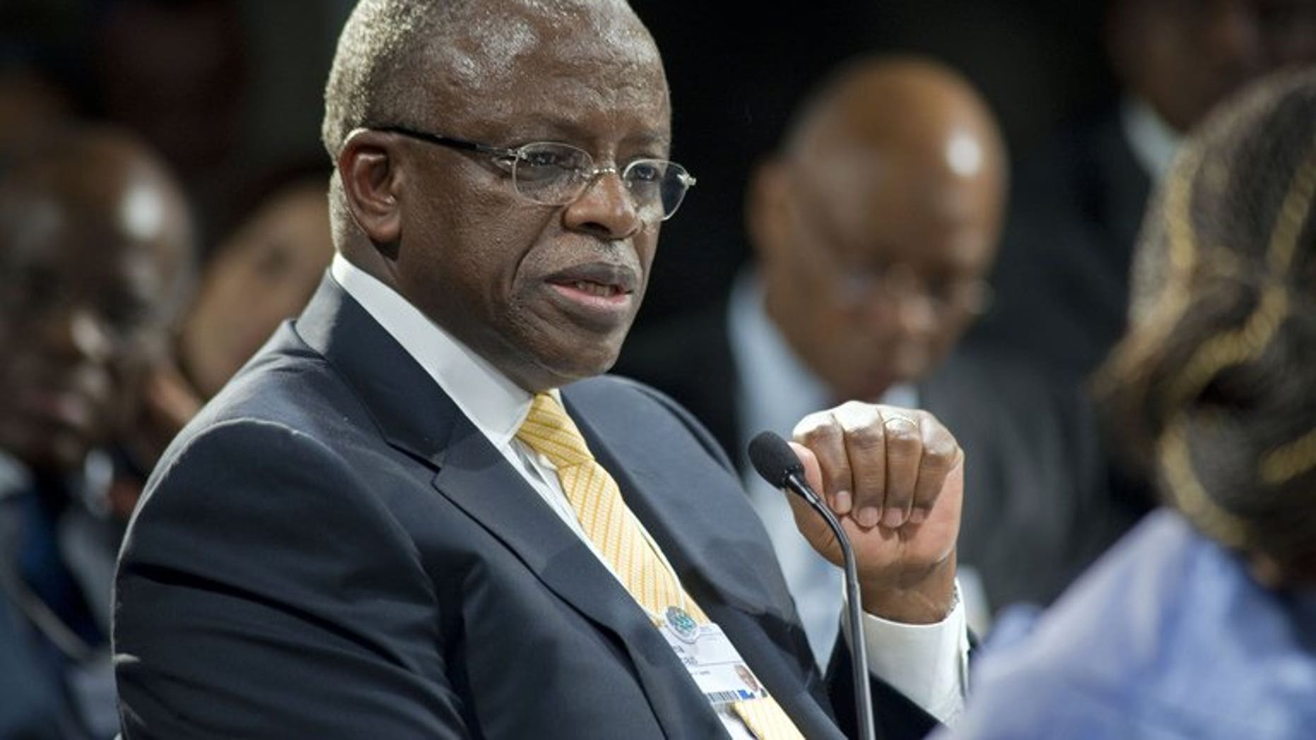 "Uganda's Prime Minister Amama Mbabazi gives a speech at the World Economic Forum meeting on Africa, on May 9, 2013, in Cape Town. Mbabazi has accepted substantial damages from Britain's Daily Mail newspaper after it falsely claimed he and his ""cronies"" siphoned off millions of dollars of foreign aid, London's High Court heard."