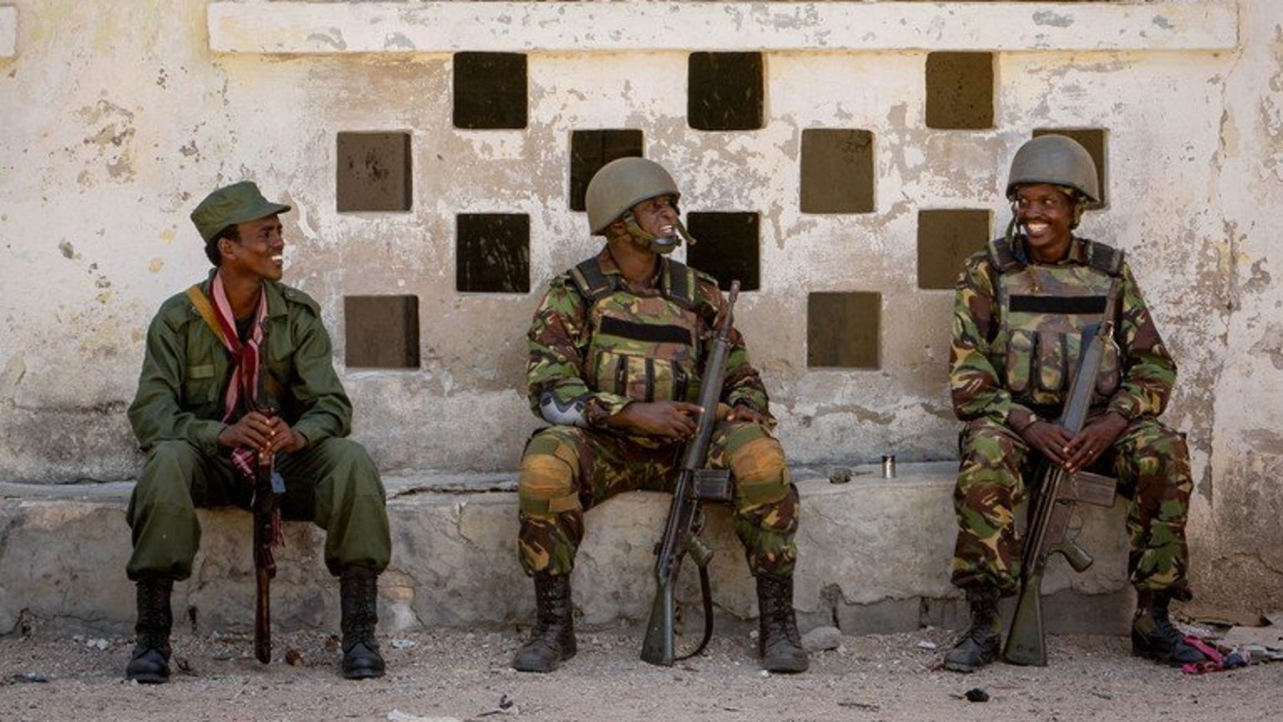 Soldiers of the Kenyan Contingent of AMISOM rest in the southern Somali port city of Kismayo on October 5, 2012. Two Kenyan officials kidnapped by the Somali Islamist group Shebab during an attack in northeastern Kenya in 2012 have been released, the Kenyan presidency announced Tuesday.