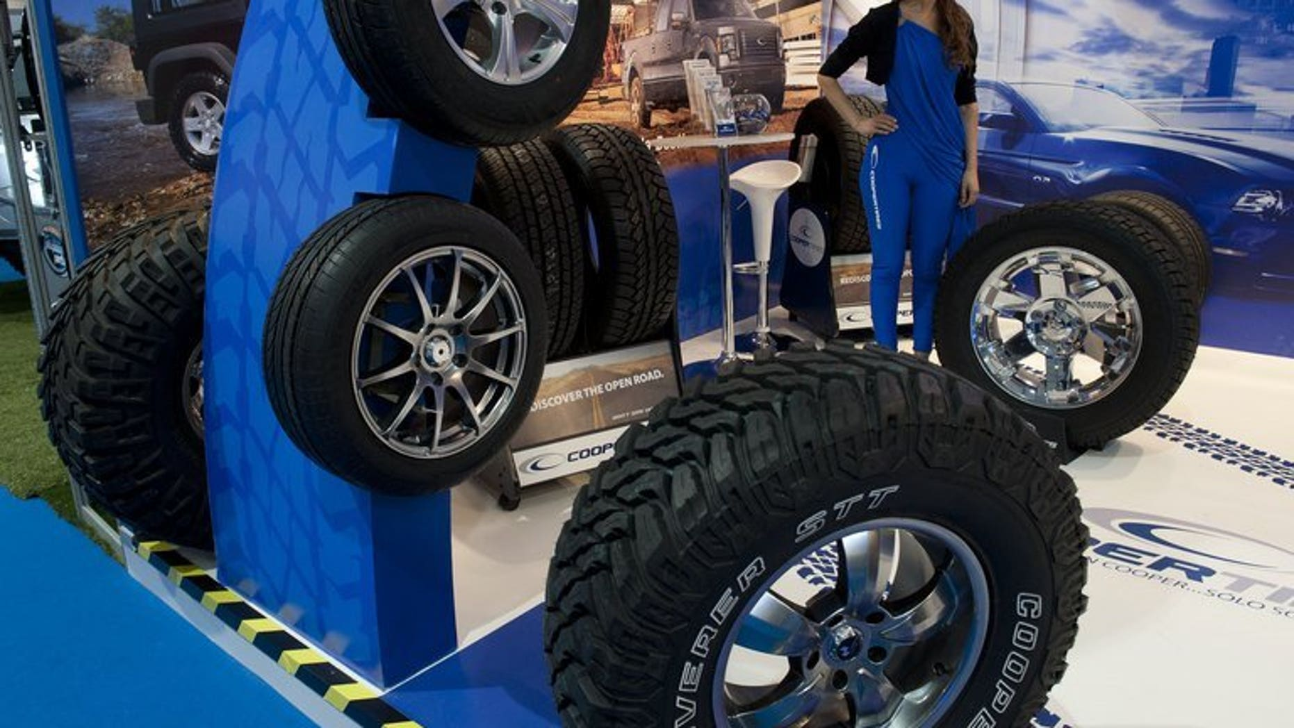 Cooper tyres are exhibited at a motor show in Santiago, on October 4, 2012. More than 5,000 Chinese workers at a Sino-US joint venture tyre manufacturer for Cooper Tireand Rubber have gone on strike against the American parent company's $2.5 billion takeover by an Indian firm, state media reported.