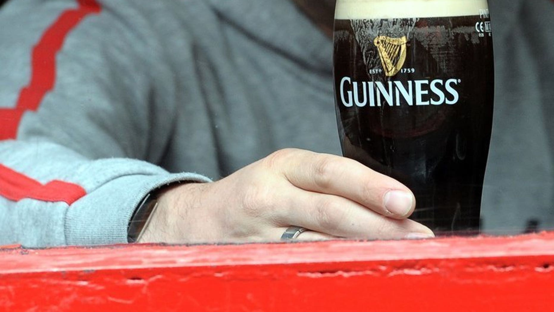 A man is pictured through the window of a bar drinking a pint of Guinness stout in The Temple Bar area of Dublin, Ireland on May 20, 2011. Diageo, the world's biggest producer of alcoholic drinks -- including Guinness -- said Wednesday that annual net profits rallied by almost a third, lifted by strength in the United States and emerging markets.