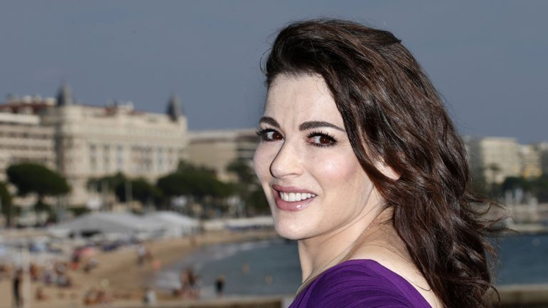 "British TV chef Nigella Lawson pictured during a photocall for the television show ""Nigellissima"" in Cannes, southeast France, on October 9, 2012. Lawson and multi-millionaire art collector Charles Saatchi moved closer to ending their decade-long marriage on Wednesday after pictures emerged showing him grabbing her neck."