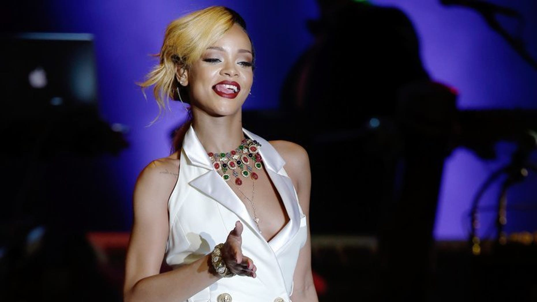 Barbadian singer Rihanna performs on stage in Monaco on July 10, 2013. Pop star Rihanna on Wednesday won a legal battle to prevent the British fashion chain Topshop from selling T-shirts bearing her image.