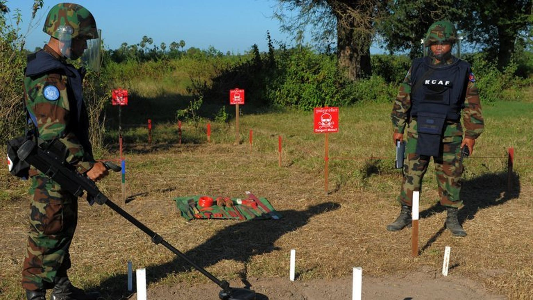 Cambodian soldiers scan for mines in Oudong, some 40 kilometers north of Phnom Penh, on November 27, 2011. Two Cambodian children and a man were killed when their buffalo cart hit an anti-tank mine left over from the country's civil war, police tell AFP.