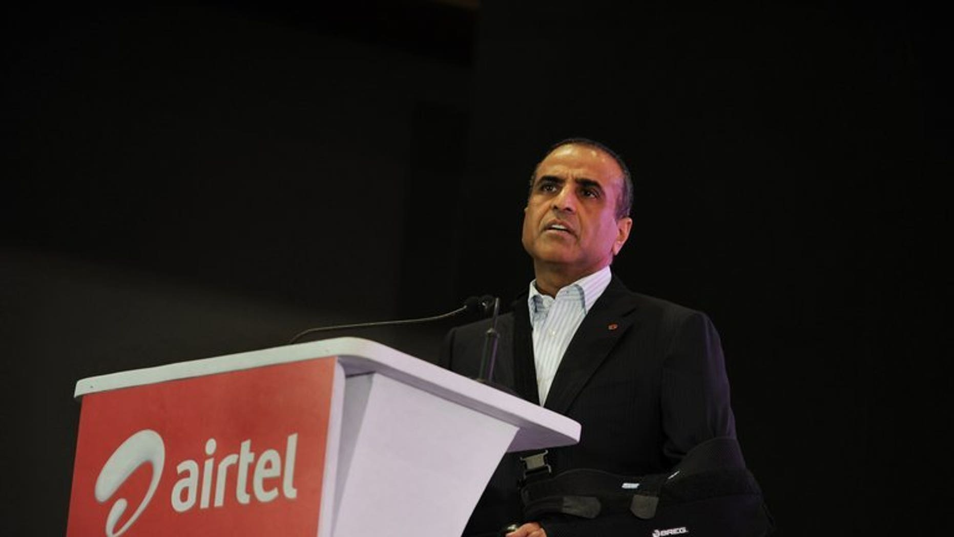 Bharti Airtel chairman Sunil Mittal gives a speech in Kolkata lastyear. India's top mobile firm has reported its 14th straight quarterly profit fall, hit by foreign exchange losses, but its shares soared on hopes of better performance as tariff wars waned.