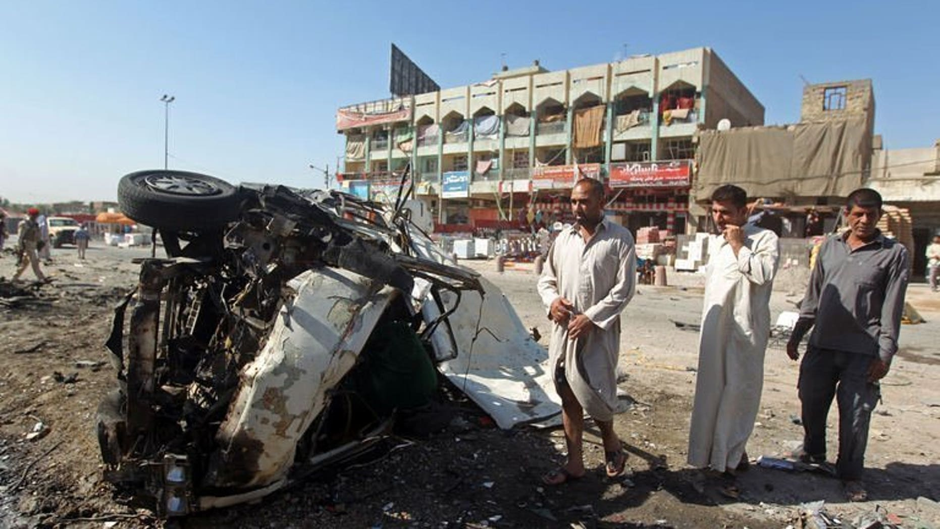 Iraqis inspect the site of a car bomb in the impoverished district of Sadr City, on July 29, 2013. At least nine people are killed and 19 wounded in a spate of attacks as the country witnesses its deadliest violence since 2008.