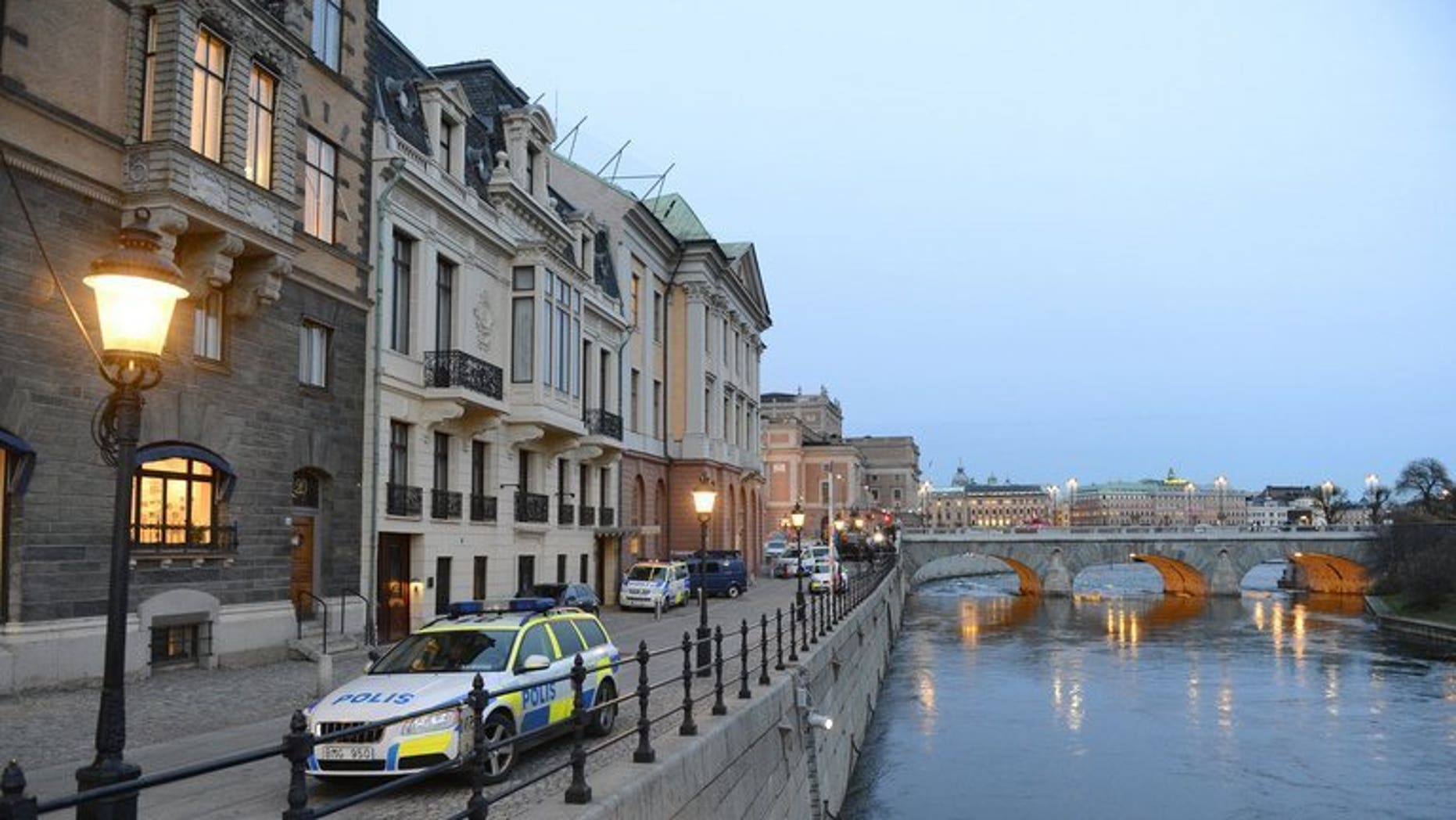 A Swedish police car is parked outside the Sagerska Palace in Stockholm, on November 9, 2012. A Swedish man long considered Scandinavia's worst serial killer has been cleared of eight murders he once confessed to, after prosecutors dropped their final charge against him.