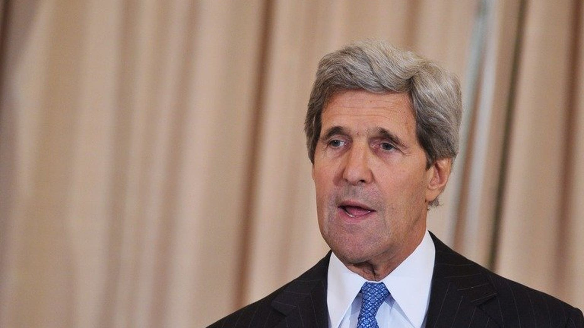 US Secretary of State John Kerry (R) speaks on July 24, 2013 at the State Department in Washington, DC. Kerry flew to Pakistan late Wednesday to press the new government on eliminating Islamist militant safe-havens as US-led troops prepare to leave Afghanistan.