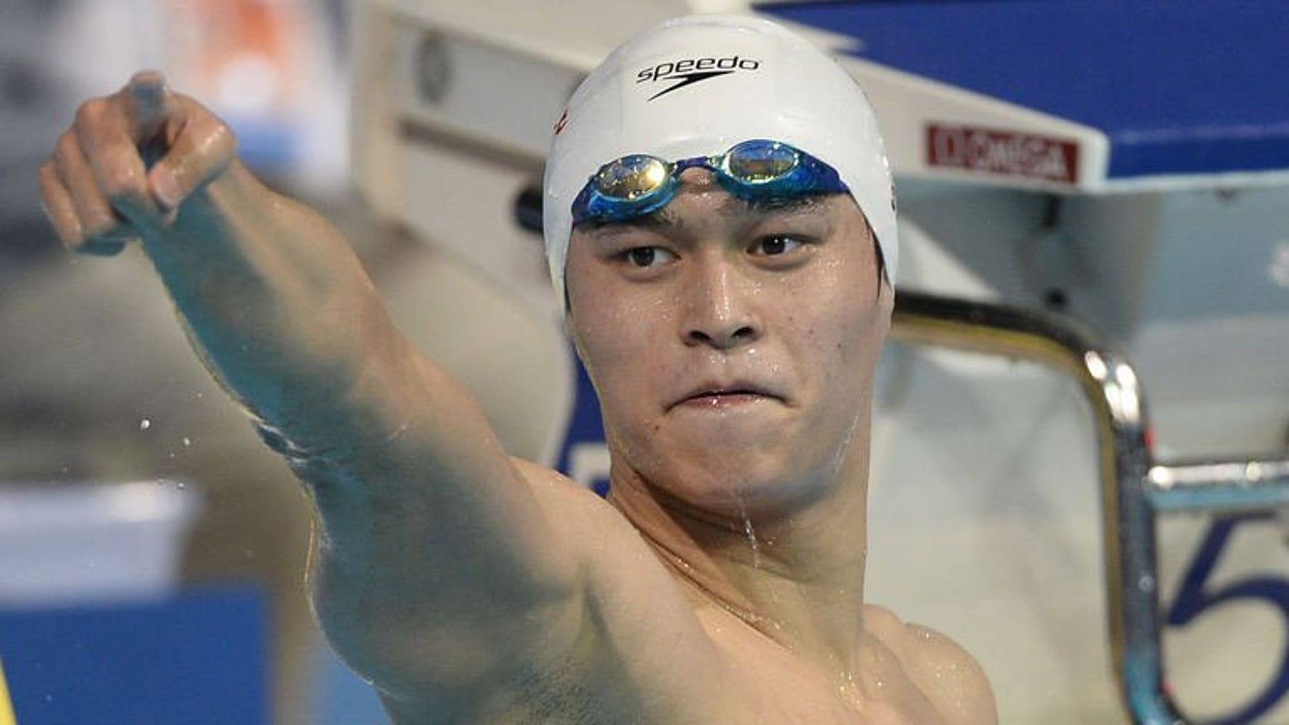 China's Sun Yang celebrates after winning the final of the men's 800-metre freestyle swimming event in the FINA World Championships at Palau Sant Jordi in Barcelona on July 31, 2013.