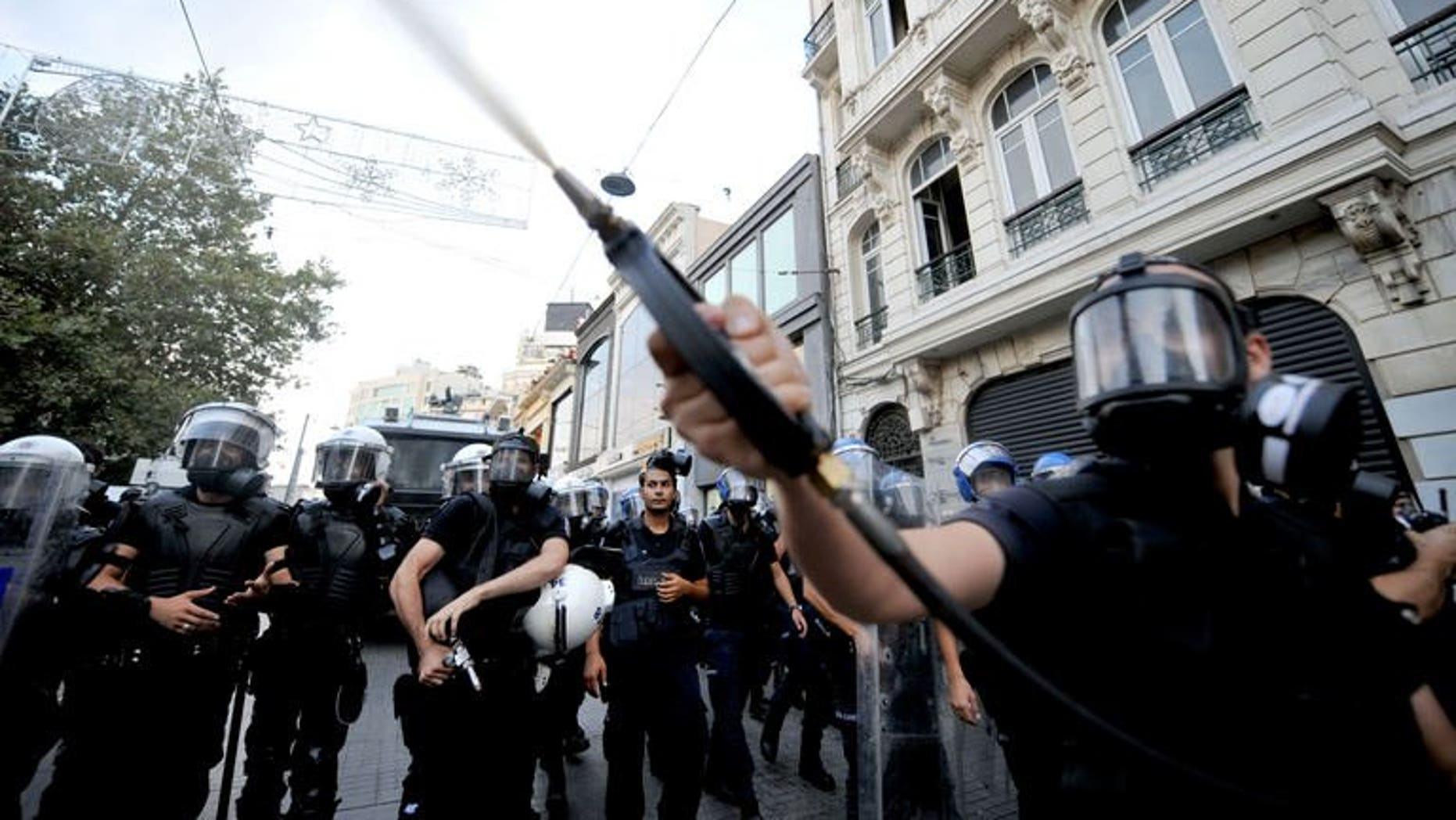 Turkish riot policemen use tear gas to disperse anti-goverment protestors during a demonstration at Taksim Square on July 31, 2013 in Istanbul.