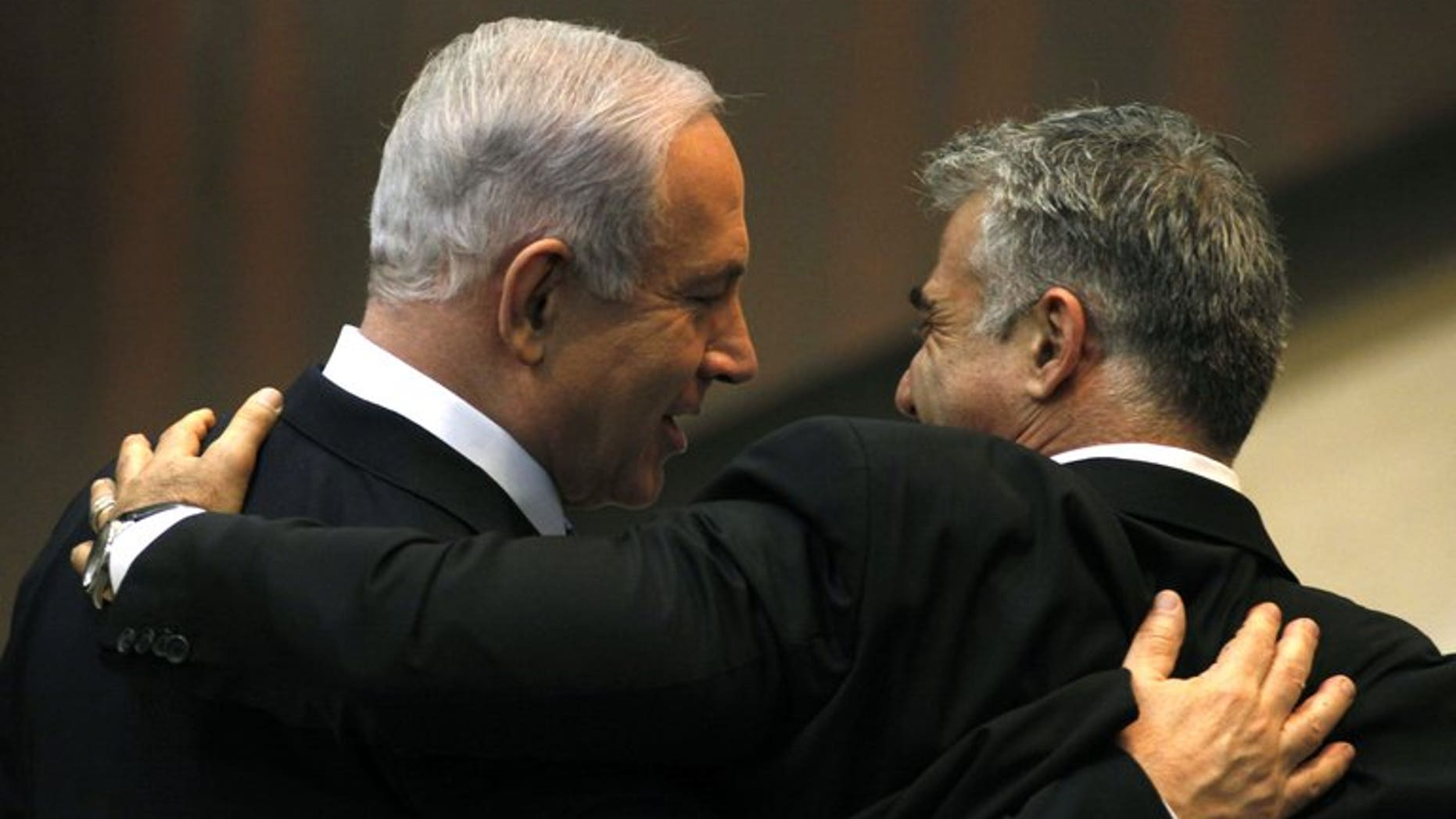 Israeli Prime Minister Benjamin Netanyahu (L) and Yair Lapid, during a parliament session on March 18, 2013 in Jerusalem. Economist Leo Leiderman was named Israel's central banker on Wednesday, days after the previous candidate pulled out after an investigation against him on a shoplifting allegation.