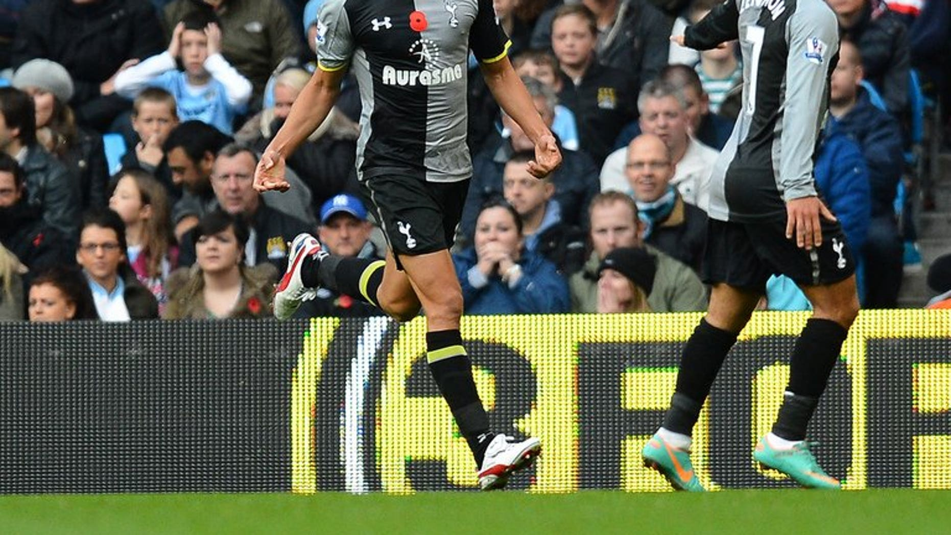 Tottenham Hotspur's English defender Steven Caulker (L) celebrates after scoring at The Etihad stadium in Manchester, north-west England on November 11, 2012. English Premier League newboys Cardiff on Wednesday signed Caulker for a club record fee believed to be in excess of eight million pounds ($12.1million), the BBC reported.