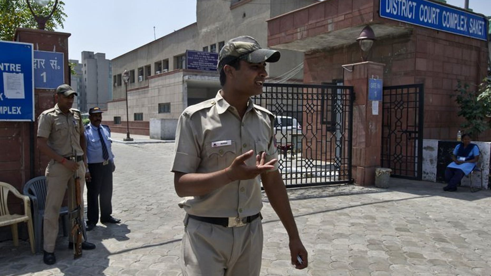 Indian police-men stand guard outside the Saket district court in New Delhi on April 8, 2013. The new police chief of India's capital said Wednesday his top priority was making the city safer for women after the fatal gang-rape of a student sparked violent protests.