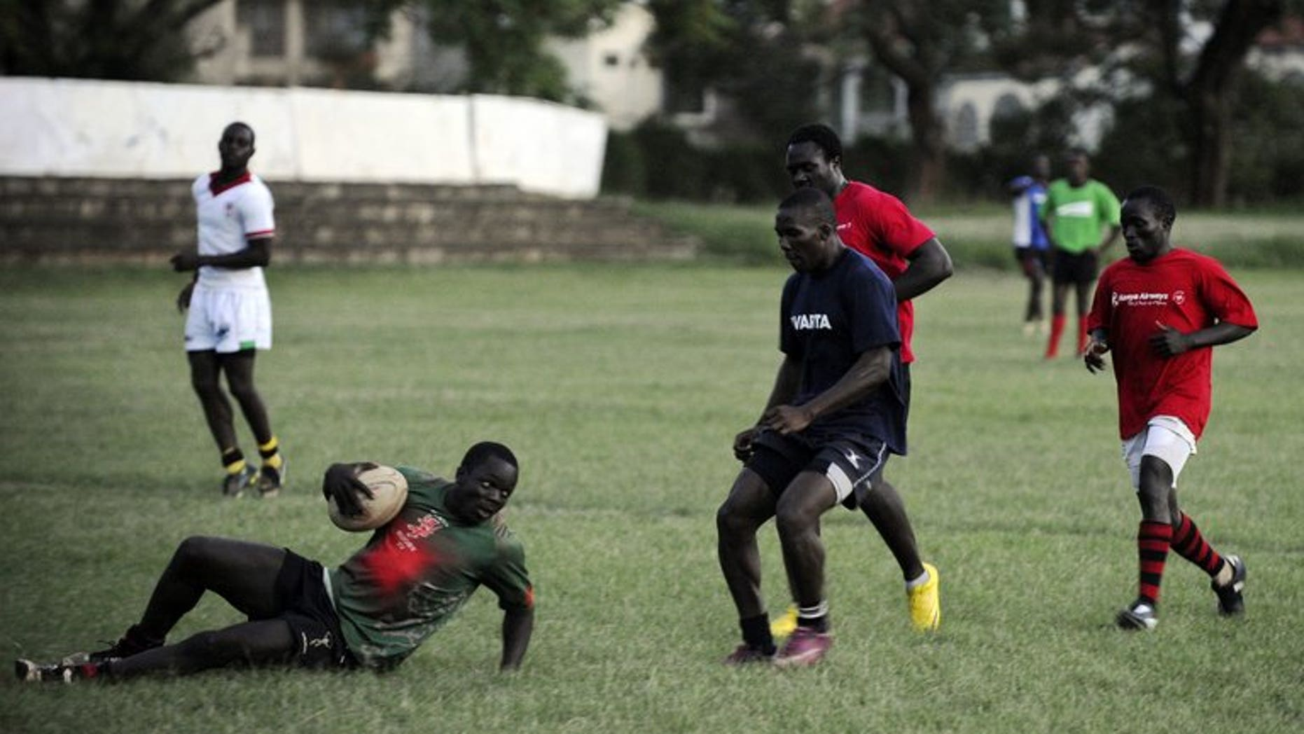 Rugby sevens Kenyan national team players take part in a training session on November 2, 2012 in Nairobi. Mike Friday resigned as Kenya Sevens head coach on Wednesday, citing too much interference in his work and disatisfaction over the lack of funding for the national team.