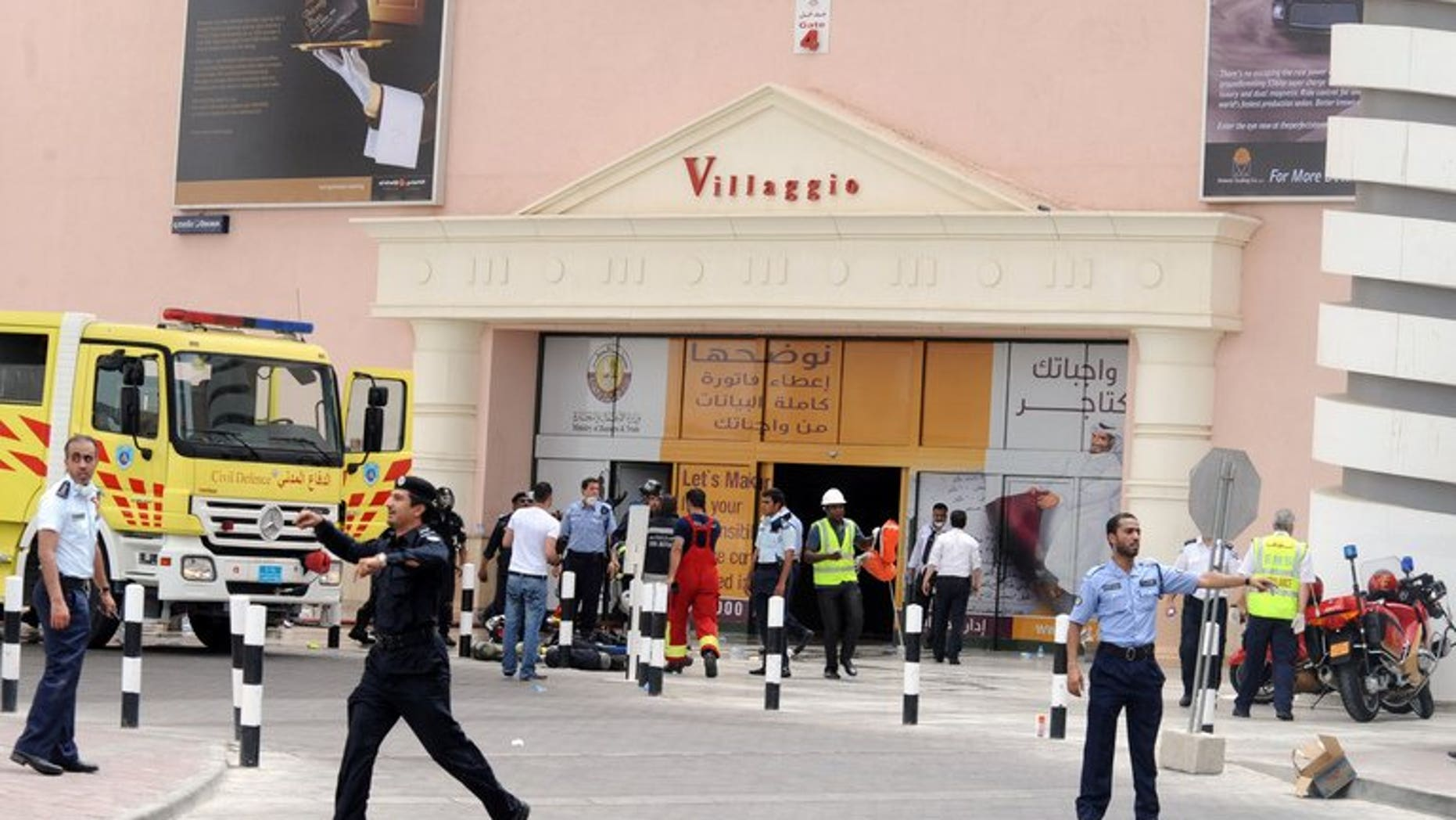 Qatari police clear traffic outside Doha's Villagio Mall after a fire broke out on May 28, 2012, killing at least 19 people, including 13 children. The parents of New Zealand triplets who died in the shopping mall fire, announced on Thursday that they have had baby twins.