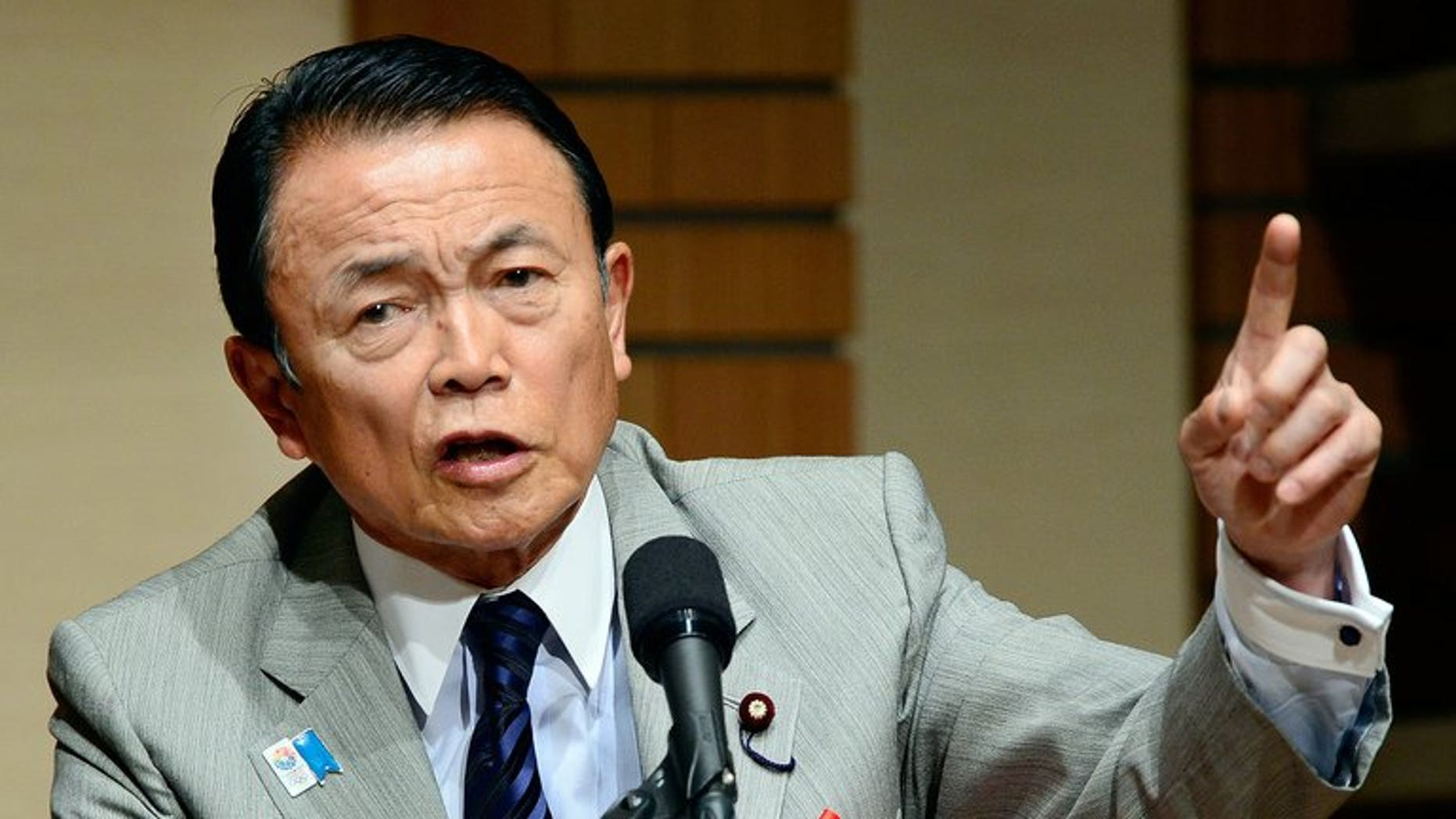 Japanese Finance and Deputy Prime Minister Taro Aso talks to the media in Tokyo, June 28, 2013. The gaffe-prone Aso has retracted controversial remarks that suggested Tokyo could learn from Nazi Germany when it comes to constitutional reform.
