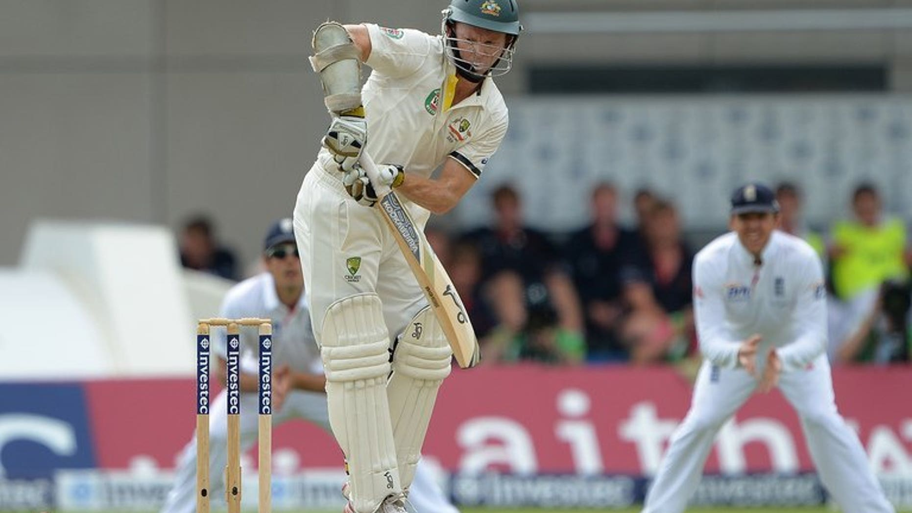 Australia's Chris Rogers (centre) bats during the third cricket test match of the 2013 Ashes series between England and Australia at Old Trafford in Manchester on August 1, 2013. Rogers's unbeaten fifty saw Australia make a steady start to their must-win third Ashes Test against England at Manchester's Old Trafford ground.