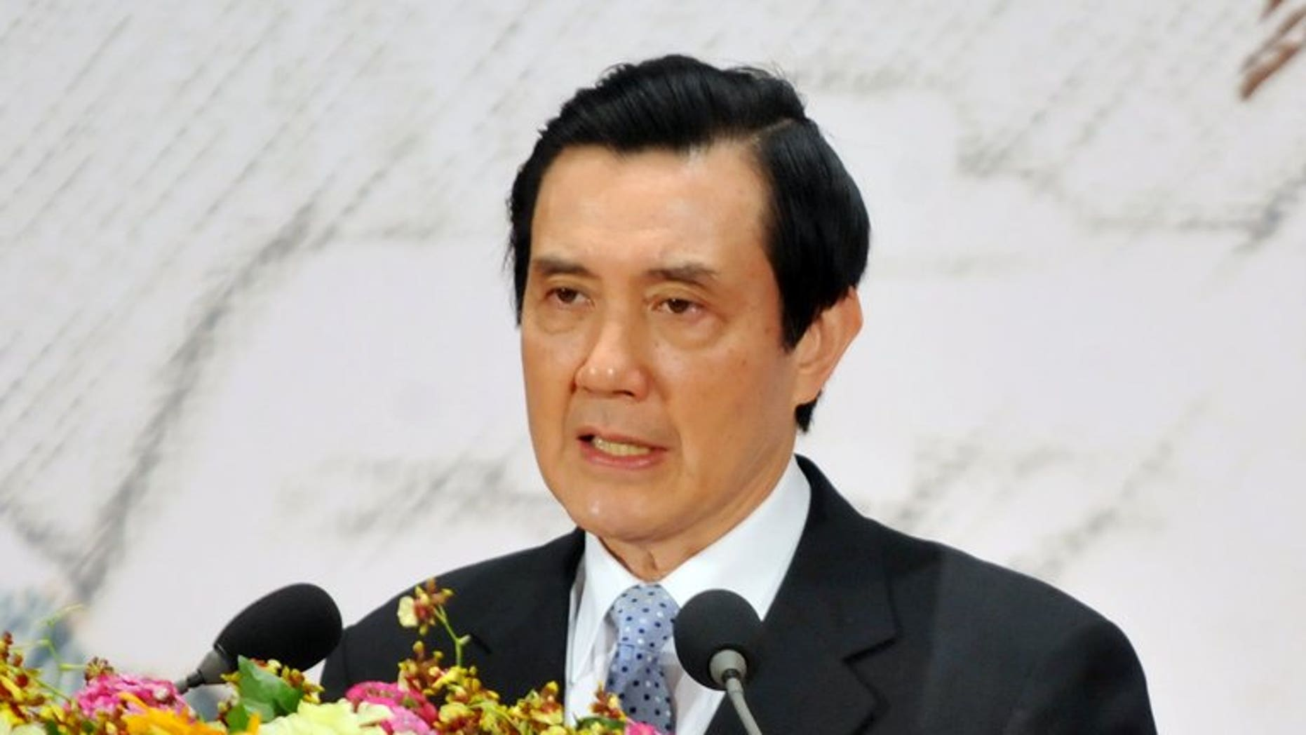 Taiwan's President Ma Ying-jeou speaks at the headquarters of the island's quasi-official Straits Exchange Foundation in Taipei on April 29, 2013. Ma defended a controversial trade pact with China following protests against the deal, saying it would benefit the island's economy.