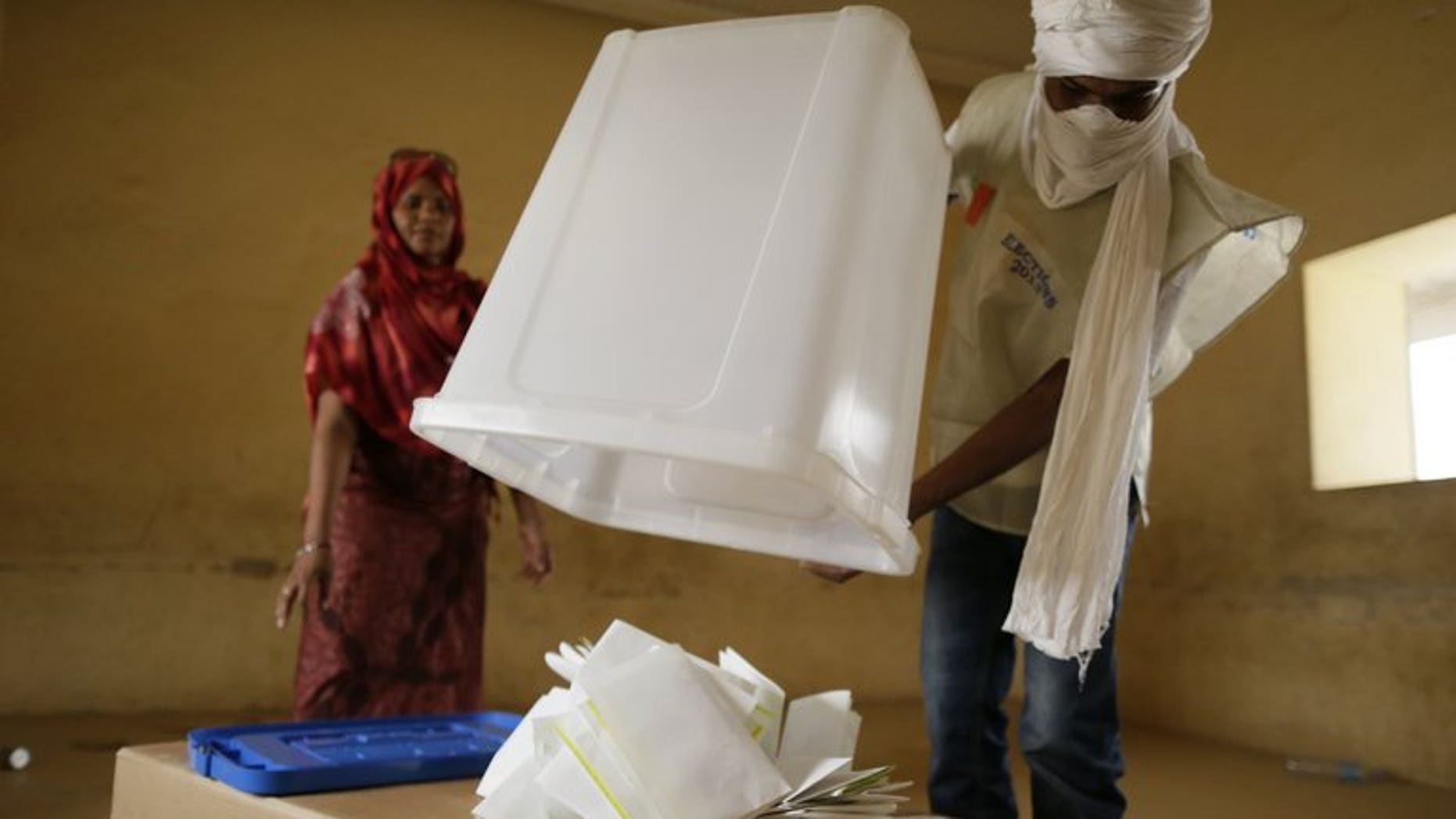 Malian electoral agents count the votes at a polling station in Kidal, northern Mali, on Monday. The results of the first round of Mali's presidential election will be announced on Friday, a day later than expected, the presidency said Thursday.