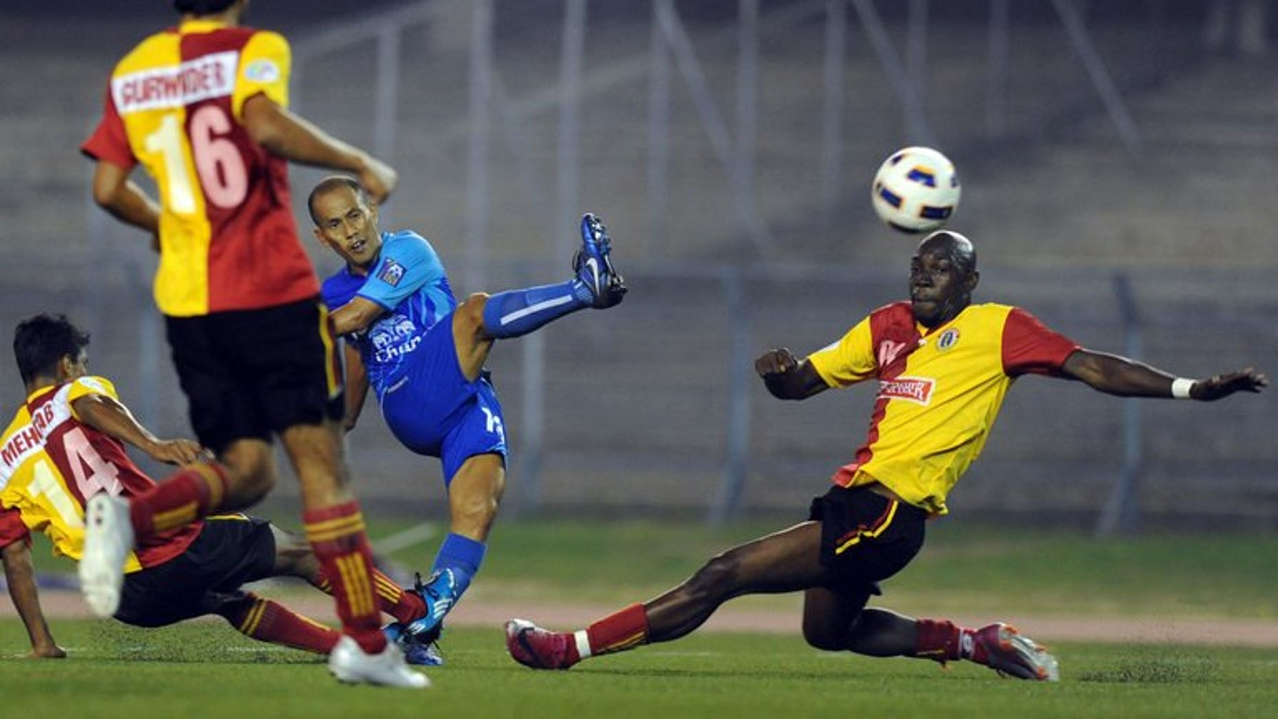 India's East Bengal players compete for the ball with Thailand's Chonburi's Chaiman Therdsak (centre) during their AFC Cup match at Salt Lake stadium in Kolkata on March 2, 2011. India's football chiefs backed a proposal to hold a new tournament inspired by cricket's popular Indian Premier League, despite fierce opposition from the country's top clubs.