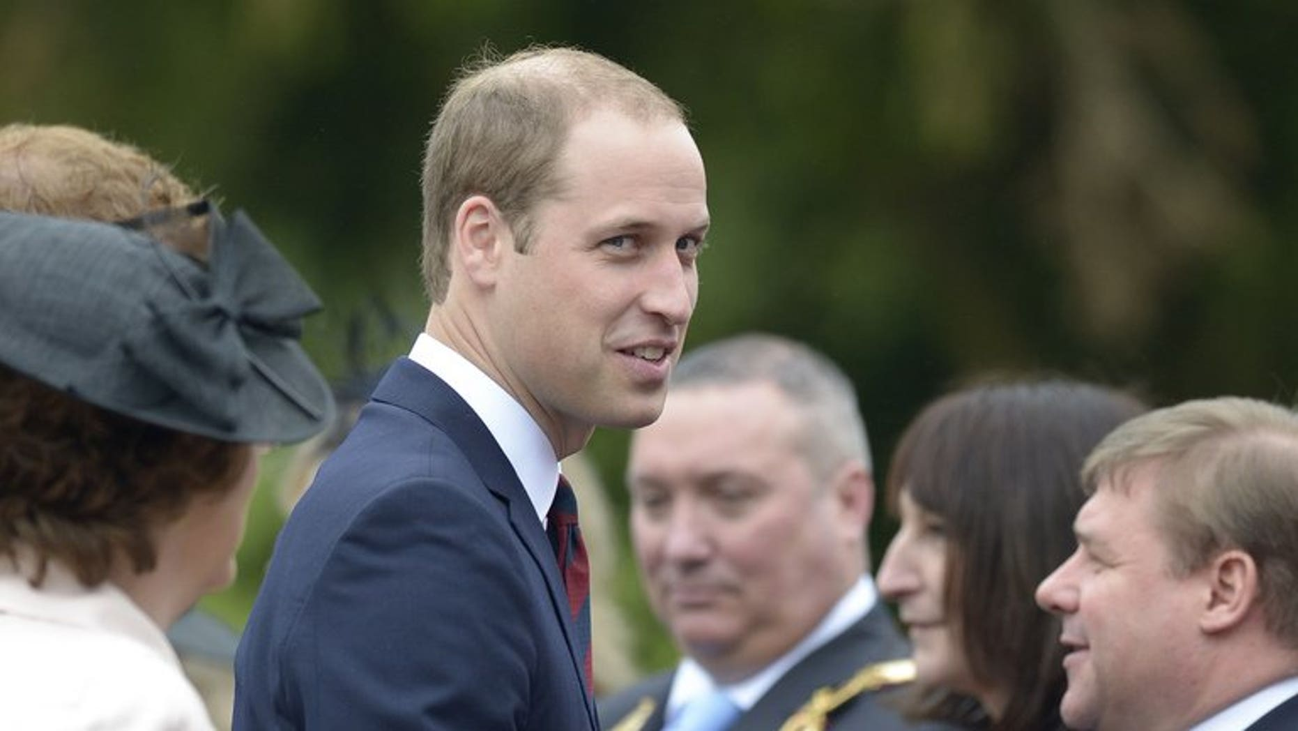 Prince William, Duke of Cambridge (C), in Tidworth, Wiltshire, southern England, on May 20, 2013. The BBC apologised on Thursday for accidentally showing an image of Britain's Prince William with a penis drawn on his head.