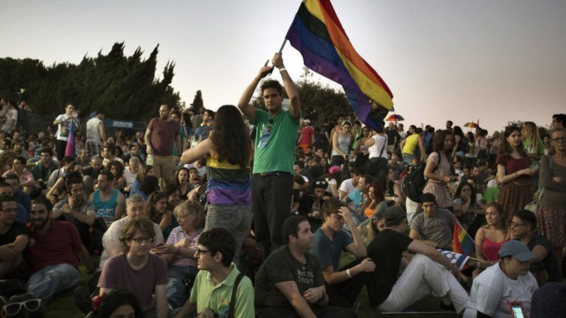 An Israeli waves a rainbow flag during the annual gay pride parade on August 1, 2013 in Jerusalem. A few thousand people marched in the gay pride parade in central Jerusalem without any serious incidents on Thursday, police said.