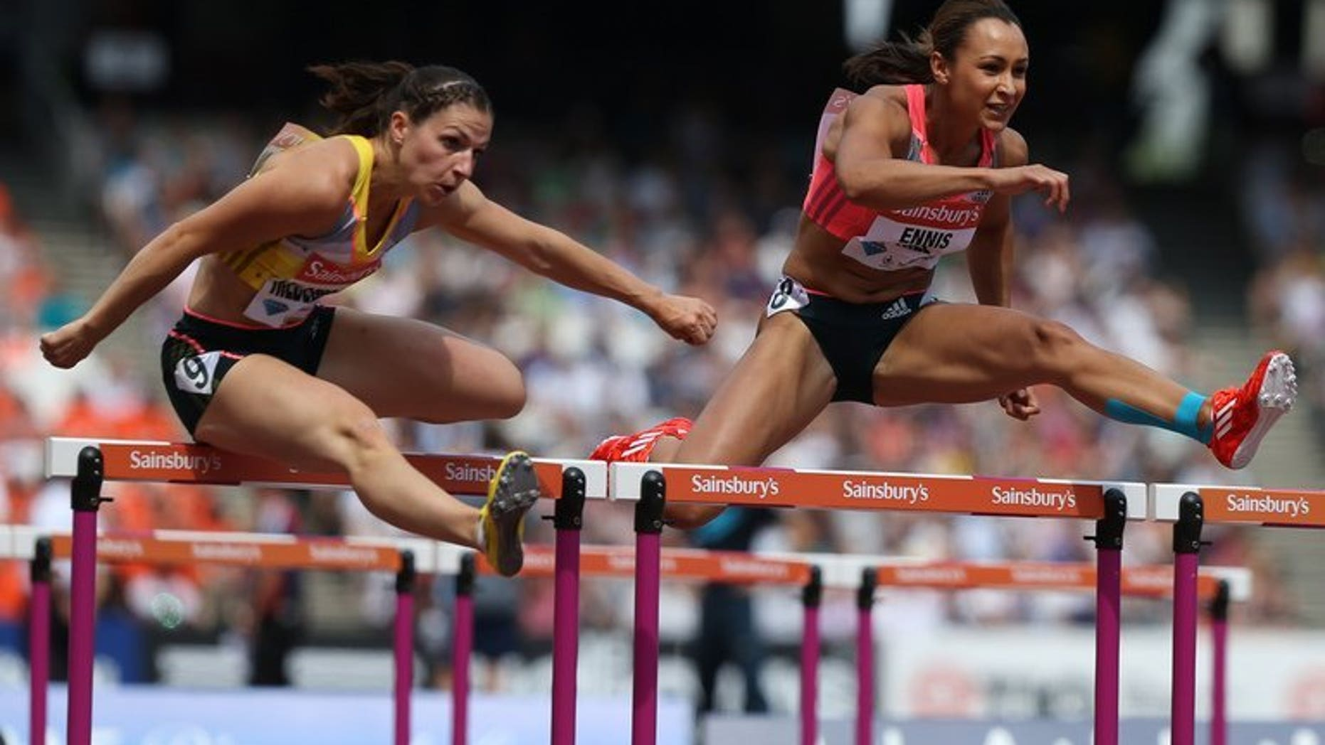 Jessica Ennis-Hill (right) outpaces Nadine Hilderbrand at the Anniversary Games in London on July 27. Ennis-Hill's coach expects the Olympic heptathlon champion to be sidelined for up to four months with the Achilles problem that forced her withdrawal from this month's world championships.
