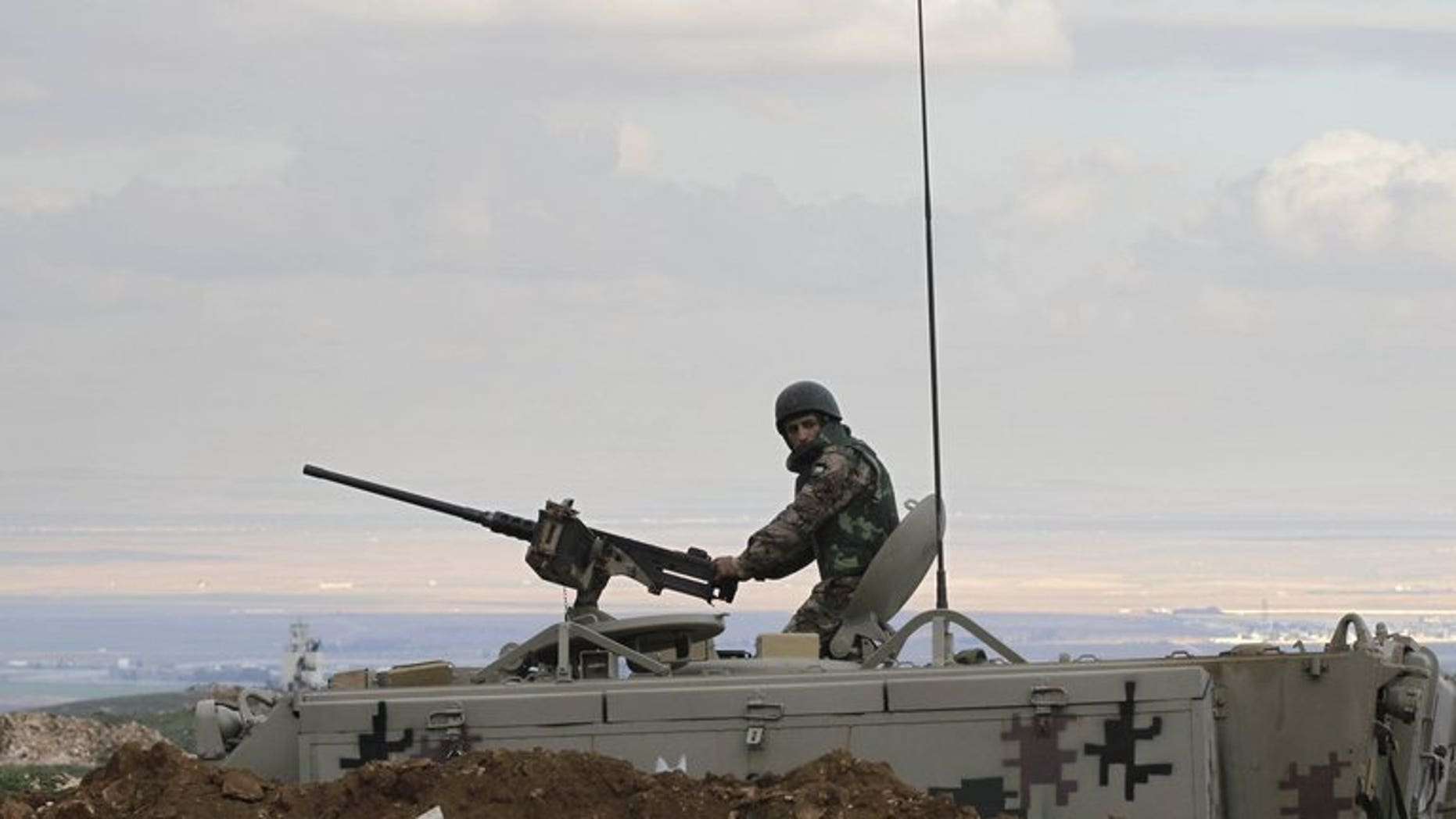 A Jordanian soldier keeps watch near Mafraq, on the border with Syria, on February 18, 2013. Jordan says its border guards have foiled an attempt to smuggle large amounts of weapons and drugs into the kingdom from Syria.