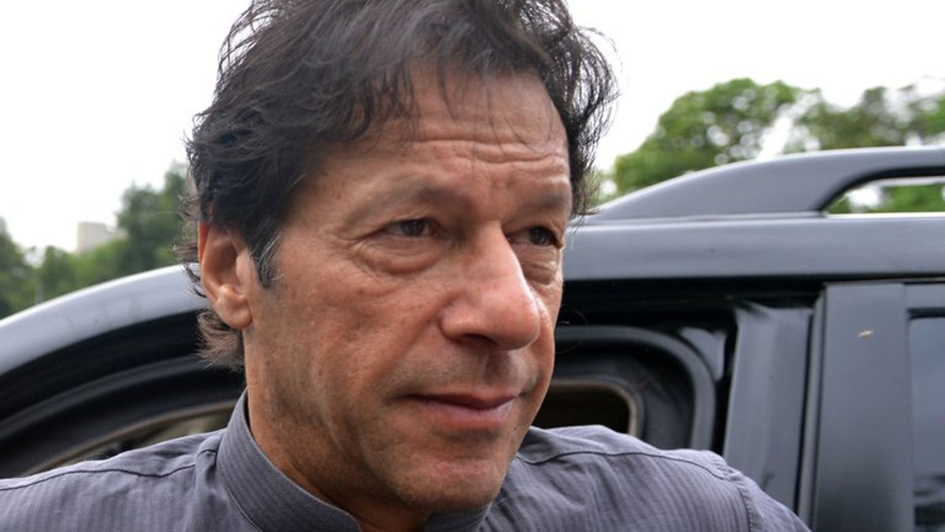 Pakistani politician Imran Khan arrives to appear before the Supreme Court in Islamabad, on August 2, 2013. The court has ordered the cricketer-turned-politician to respond in more detail over allegations that he committed contempt by making derogatory remarks against the judges.