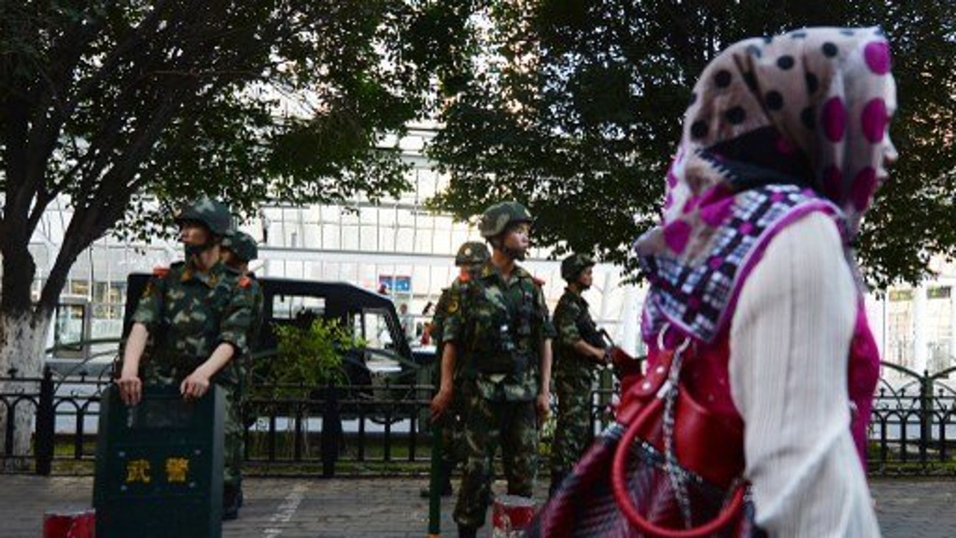 Chinese paramilitary police stand guard in the Muslim Uighur minority area of Urumqi, Xinjiang Province on June 30, 2013. Human rights conditions in China are worsening, a senior US official said Friday, accusing Beijing of harassing activists' family members and repressing ethnic and religious minorities.